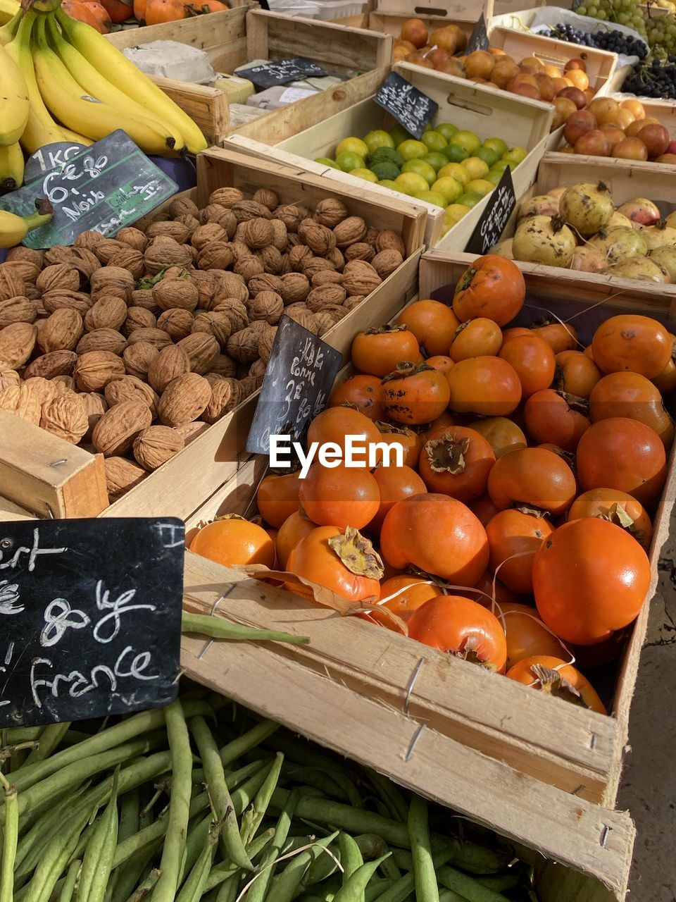 food and drink, food, market, healthy eating, retail, freshness, market stall, wellbeing, for sale, large group of objects, fruit, choice, price tag, variation, container, abundance, high angle view, crate, vegetable, day, no people, sale, retail display, organic, outdoors, ripe, consumerism
