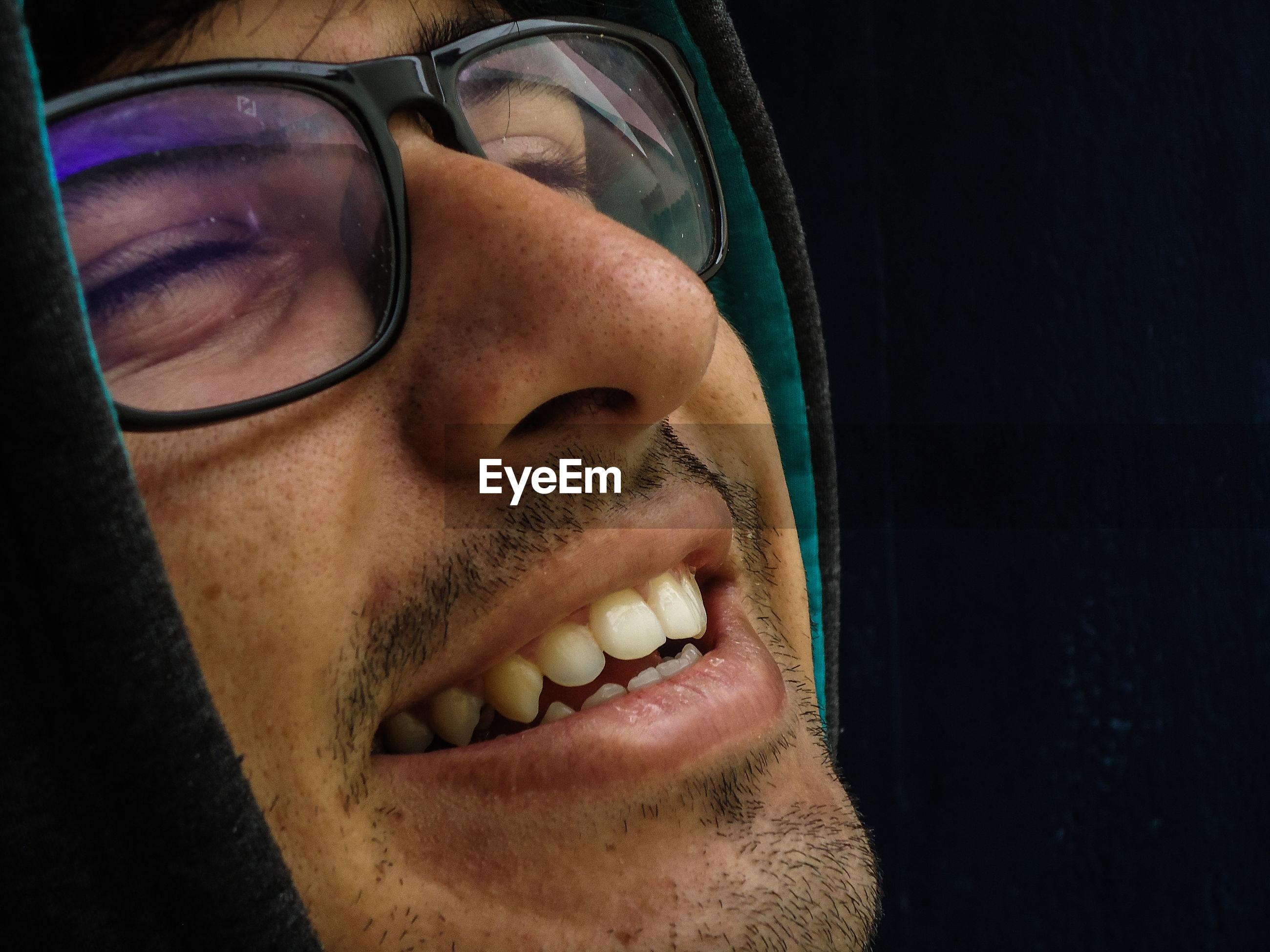 Close-up of smiling man wearing eyeglasses