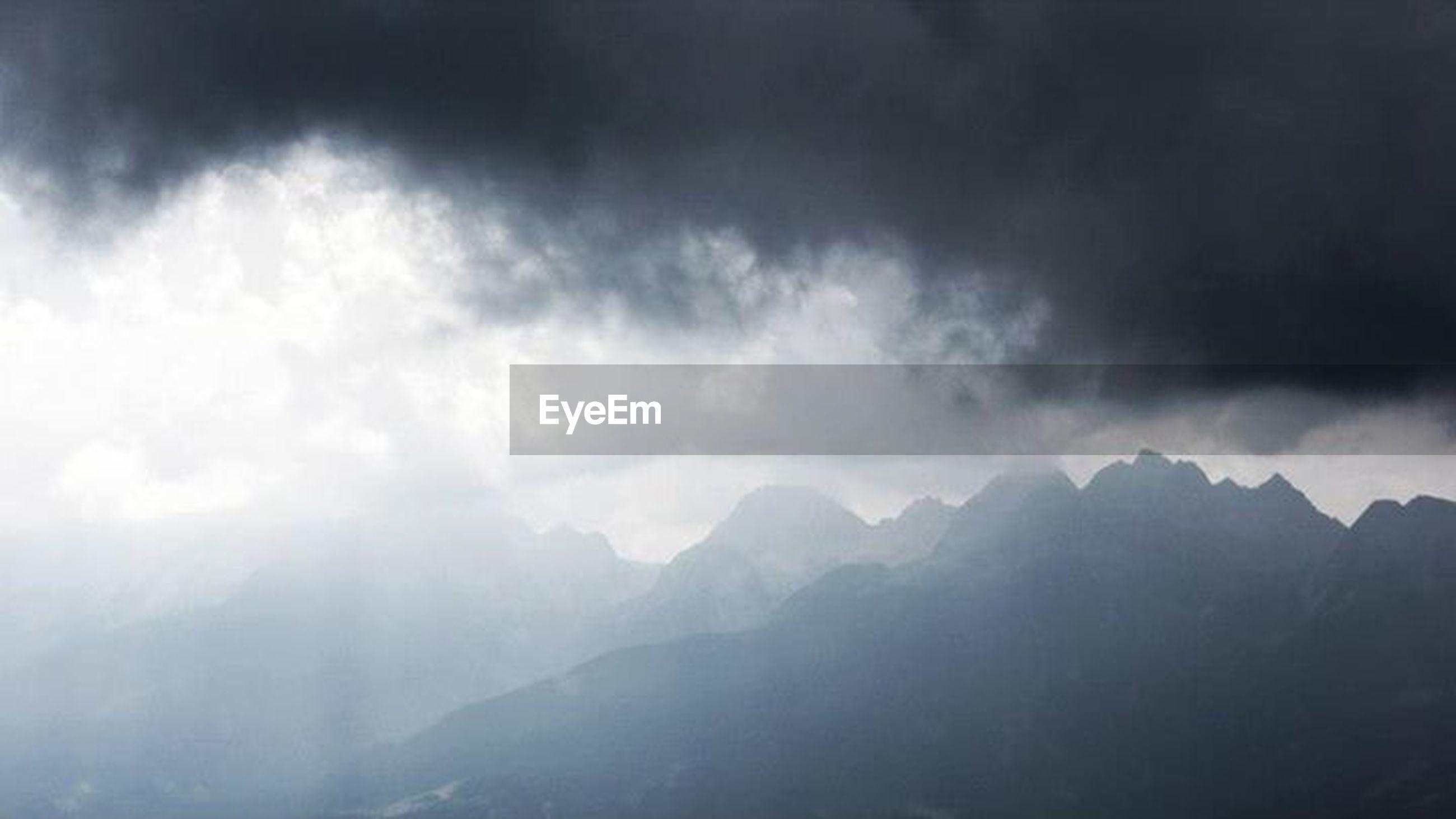 mountain, scenics, sky, cloud - sky, weather, tranquil scene, beauty in nature, cloudy, tranquility, mountain range, nature, overcast, landscape, storm cloud, idyllic, fog, cloud, non-urban scene, majestic, cloudscape