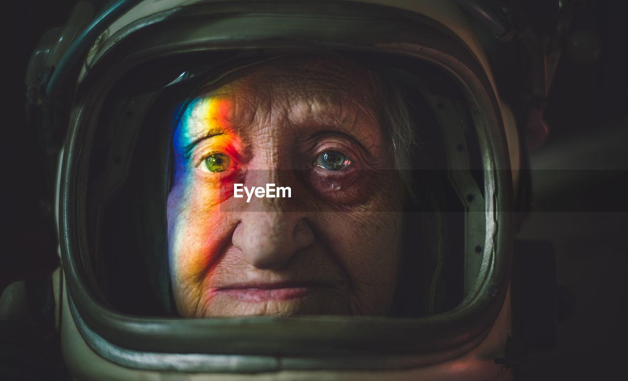 Close-up portrait senior woman wearing space suit