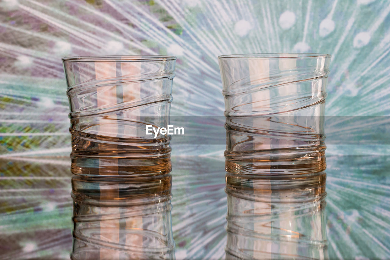 CLOSE-UP OF GLASS OF WATER IN CONTAINER