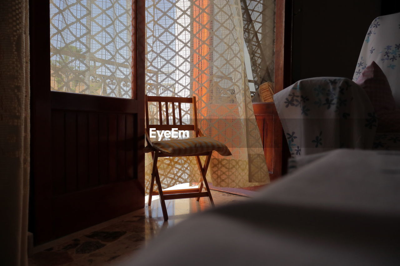 Empty chair in room at home