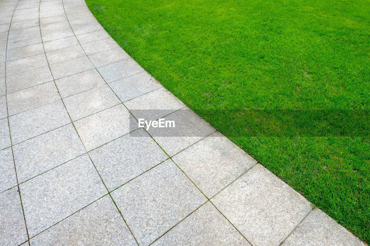 grass, footpath, green color, plant, day, nature, no people, high angle view, growth, outdoors, park, field, land, direction, park - man made space, lawn, paving stone, full frame, pattern, stone, concrete, garden path