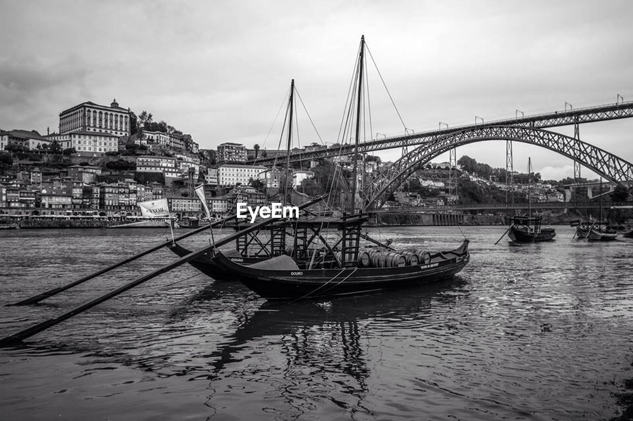 built structure, architecture, building exterior, nautical vessel, transportation, bridge - man made structure, river, water, sky, mode of transport, waterfront, outdoors, city, no people, moored, day, travel destinations, harbor, nature