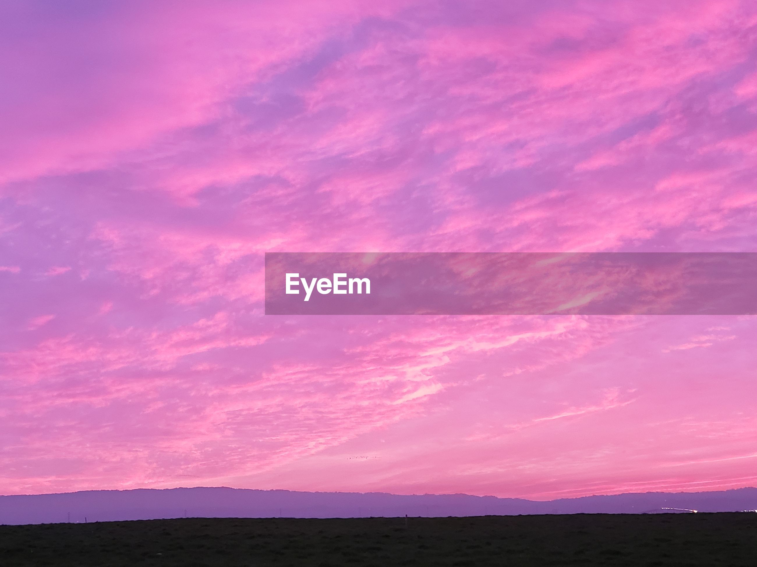 Scenic view of silhouette landscape against sky during sunset