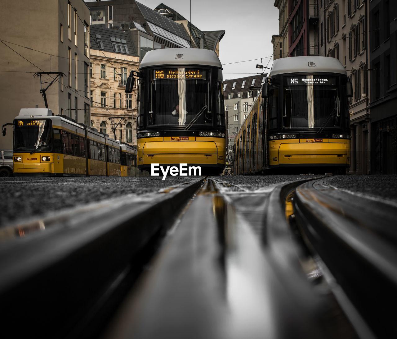 VIEW OF TRAIN AT RAILROAD TRACKS