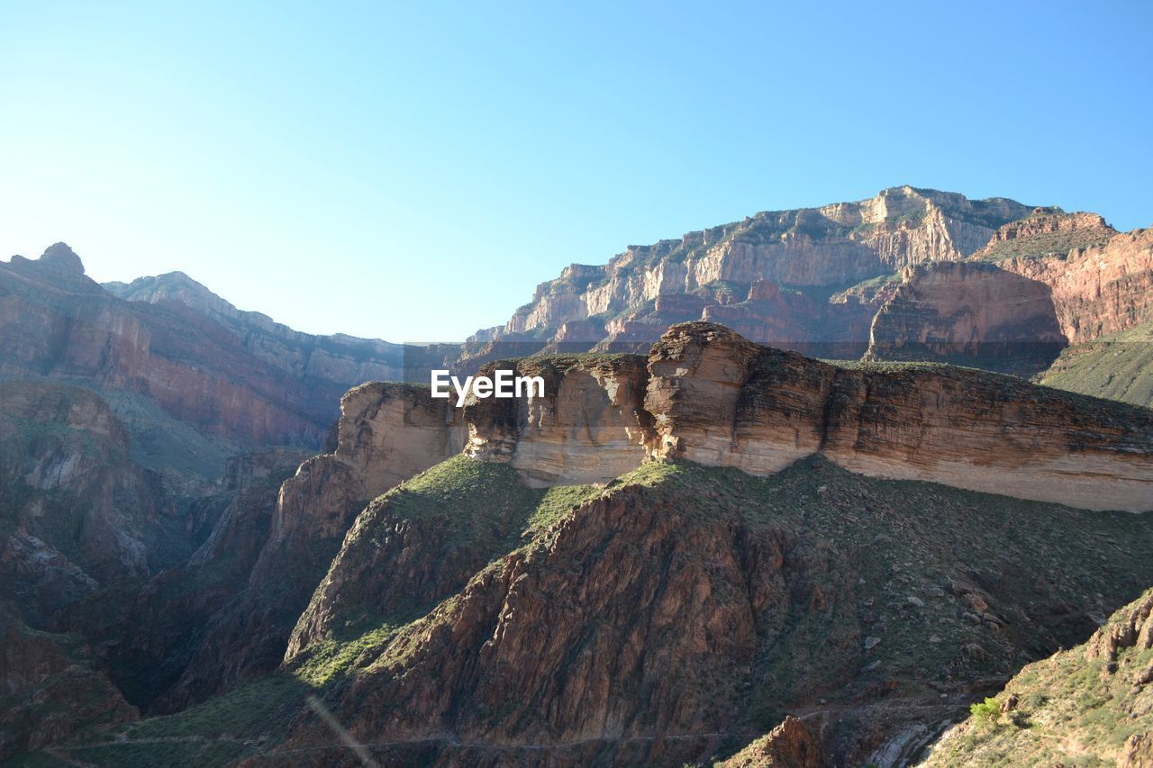 Scenic View Of Rocky Mountains At Grand Canyon National Park Against Clear Sky