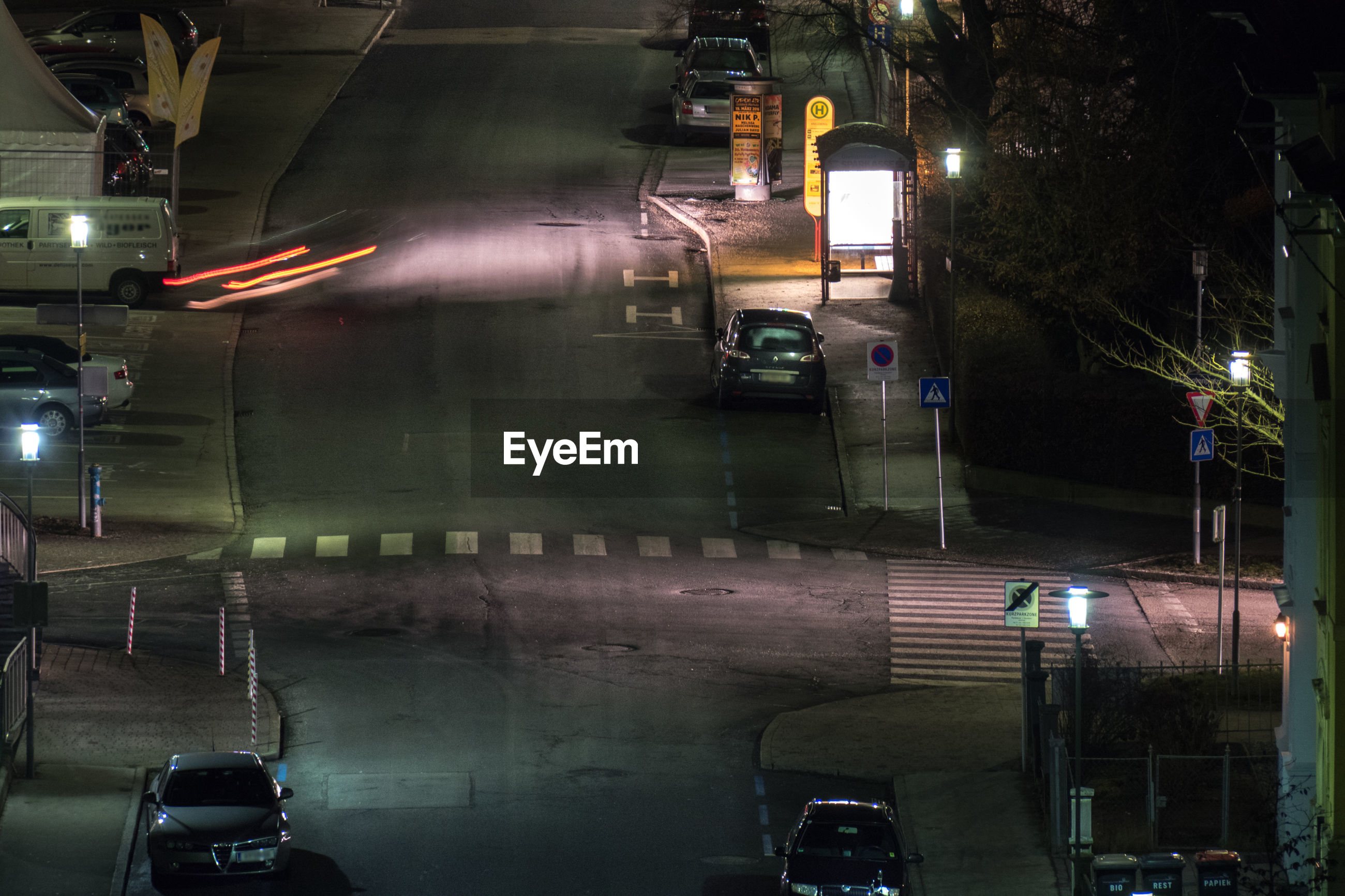 High angle view of cars parked on street at night
