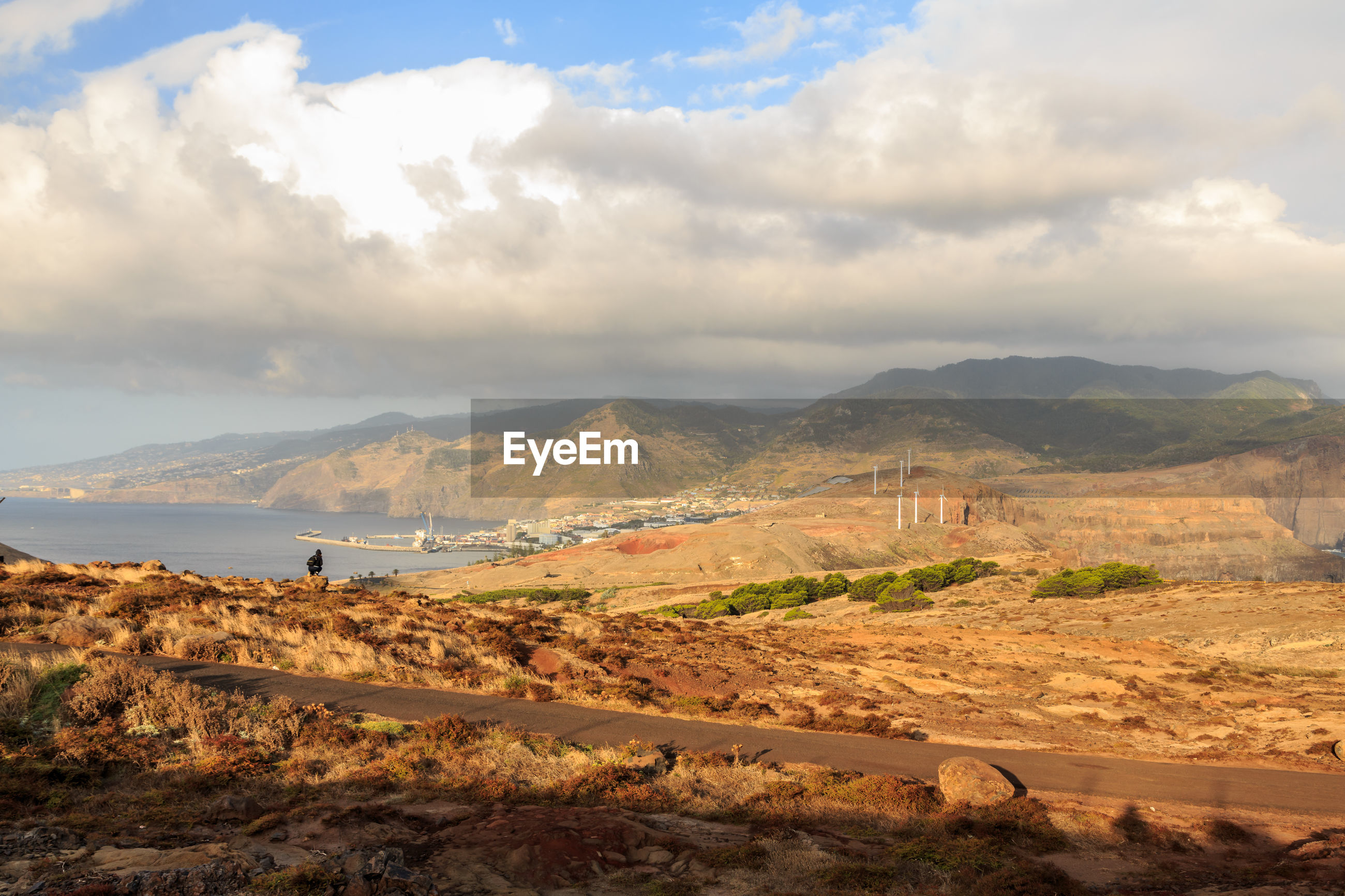 Scenic view of landscape and sea against sky