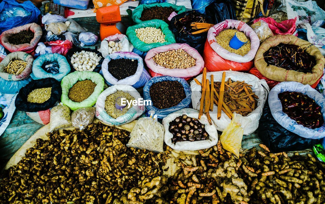variation, choice, for sale, retail, abundance, large group of objects, spice, market stall, market, high angle view, food and drink, food, collection, small business, no people, multi colored, day, arrangement, freshness, sack, outdoors, healthy eating, close-up