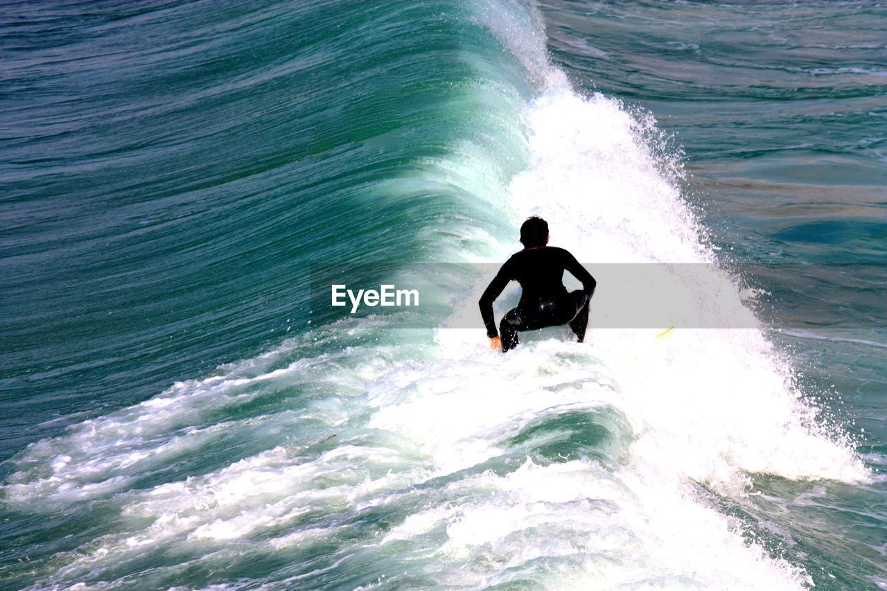 sea, wave, motion, water, surf, nature, waterfront, real people, adventure, surfing, beauty in nature, day, wake - water, outdoors, one person, lifestyles, extreme sports, men, jet boat, nautical vessel, wake, power in nature, horizon over water, force