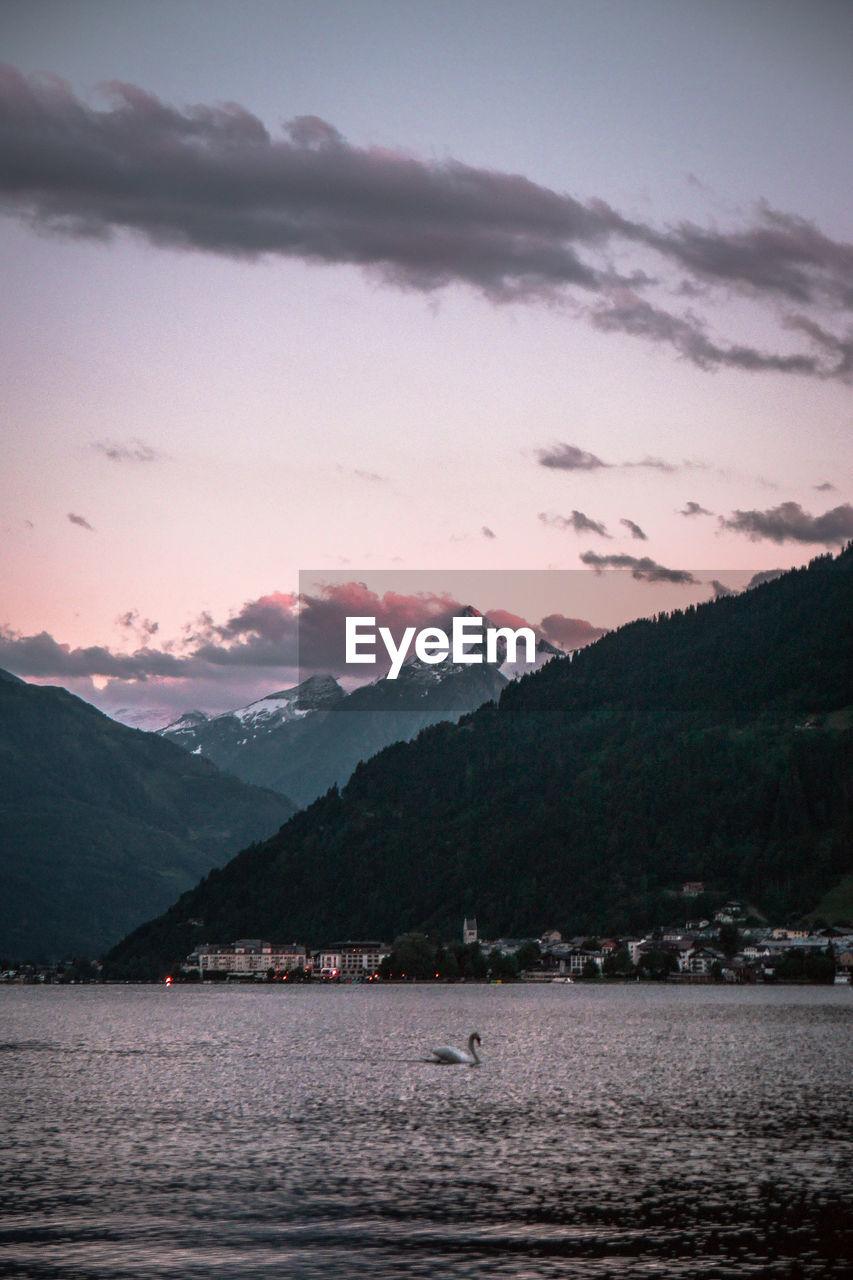 mountain, sky, beauty in nature, mountain range, scenics - nature, cloud - sky, water, tranquil scene, tranquility, sunset, nature, no people, waterfront, lake, dusk, non-urban scene, idyllic, outdoors, mountain peak
