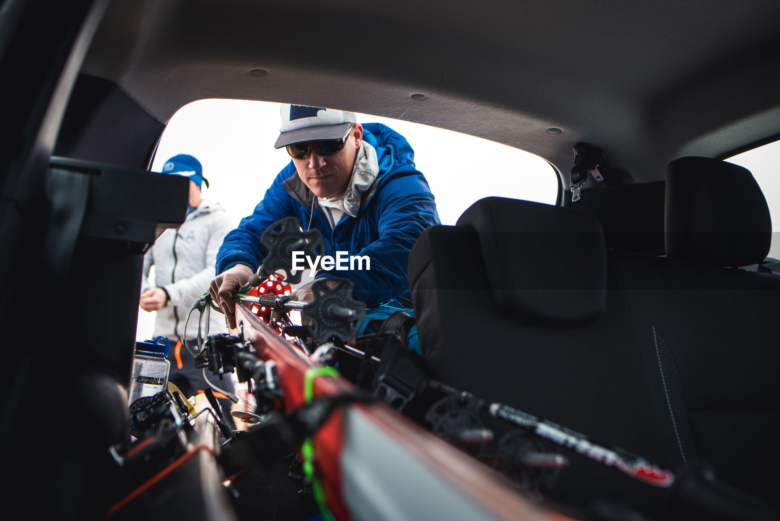 PEOPLE WORKING ON CAR