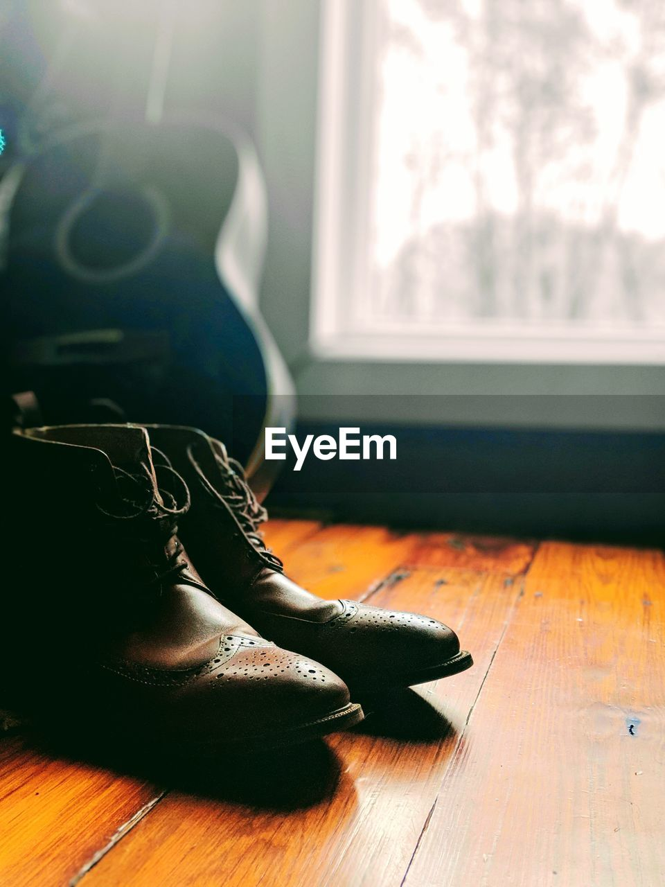 indoors, flooring, window, home interior, hardwood floor, wood, day, close-up, wood - material, table, sunlight, no people, lifestyles, focus on foreground, shoe, still life, nature