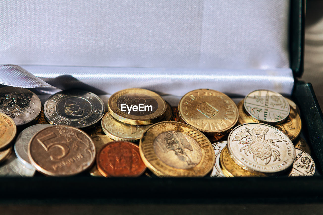 CLOSE-UP OF COINS ON TABLE WITH TEXT