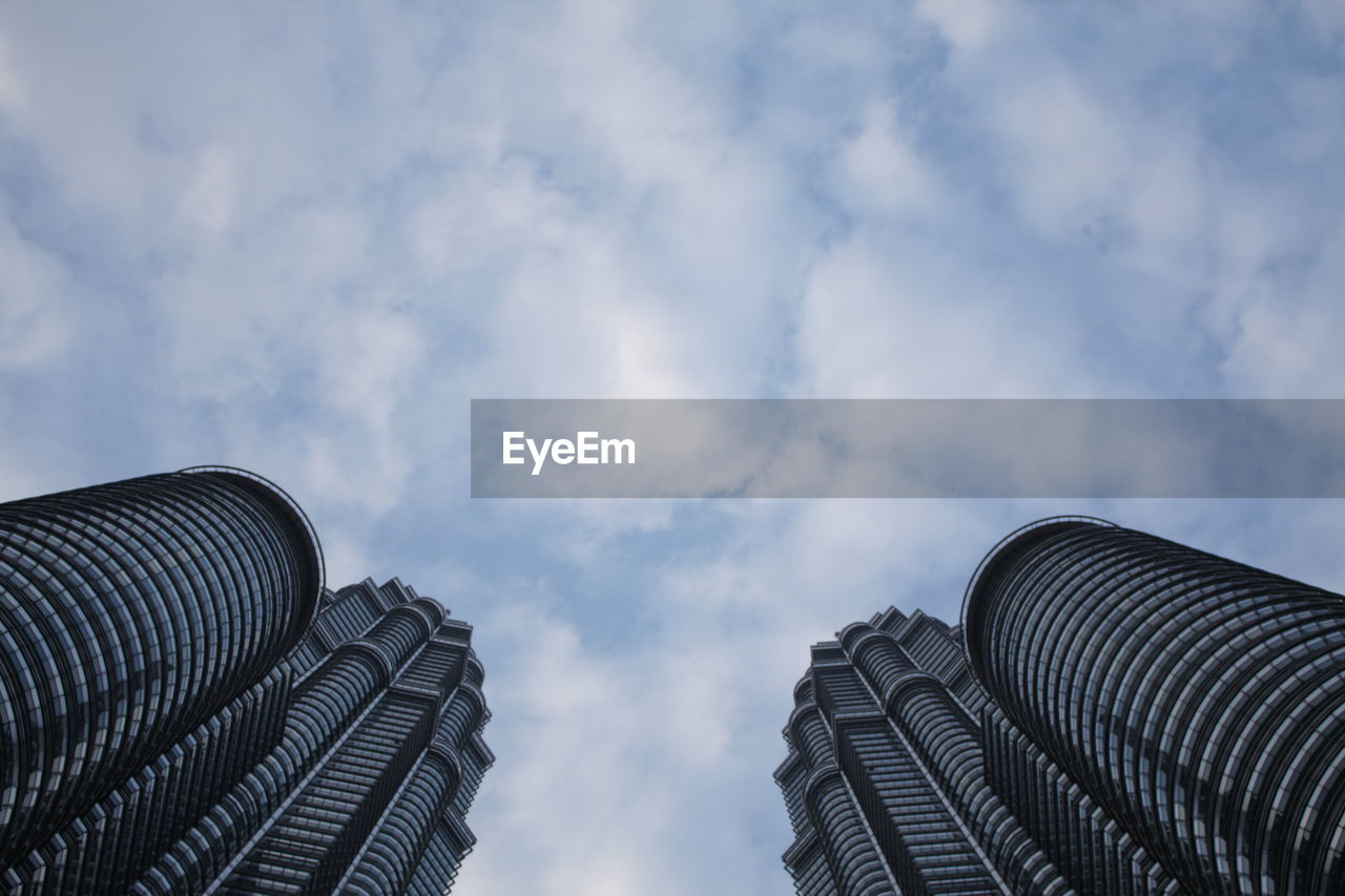 sky, architecture, cloud - sky, built structure, building exterior, low angle view, nature, building, no people, city, modern, day, skyscraper, outdoors, office building exterior, industry, high section, tower, tall - high, place, location