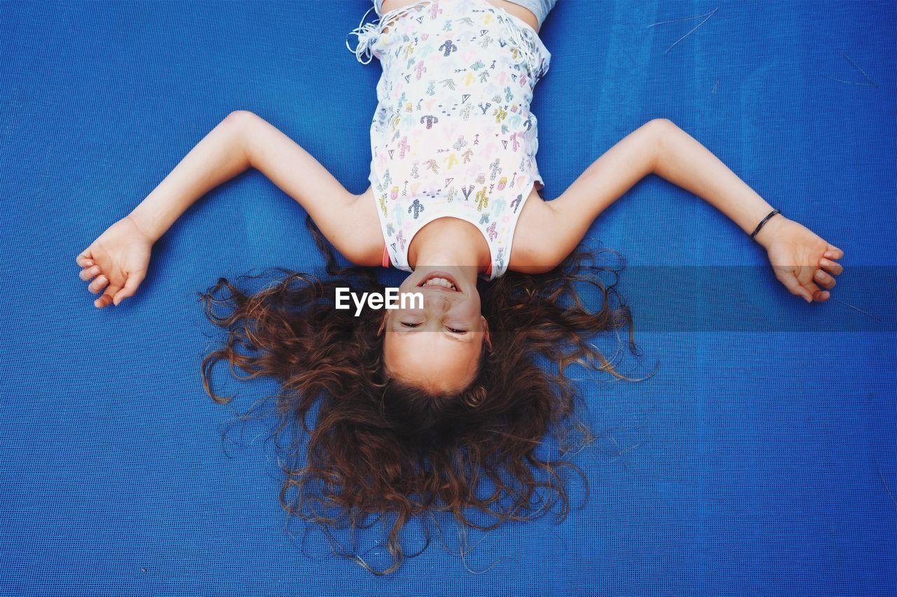 Portrait Of Girl Lying On Trampoline