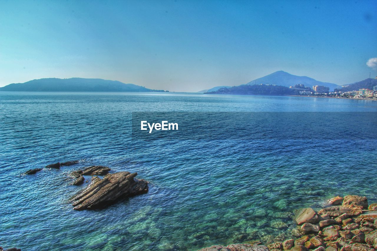 sea, beauty in nature, nature, tranquil scene, scenics, water, tranquility, rock - object, mountain, outdoors, sky, no people, day, waterfront, blue