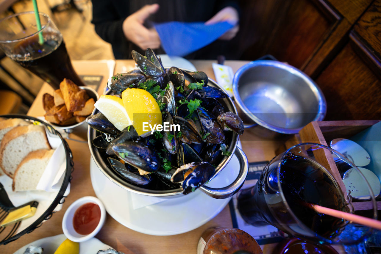 High Angle View Of Mussels In Container On Table