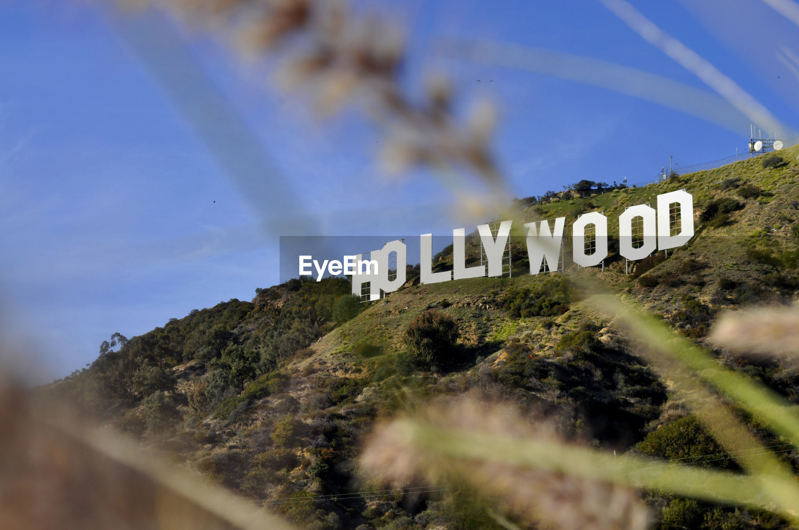 Low angle view of hollywood on mountains against sky