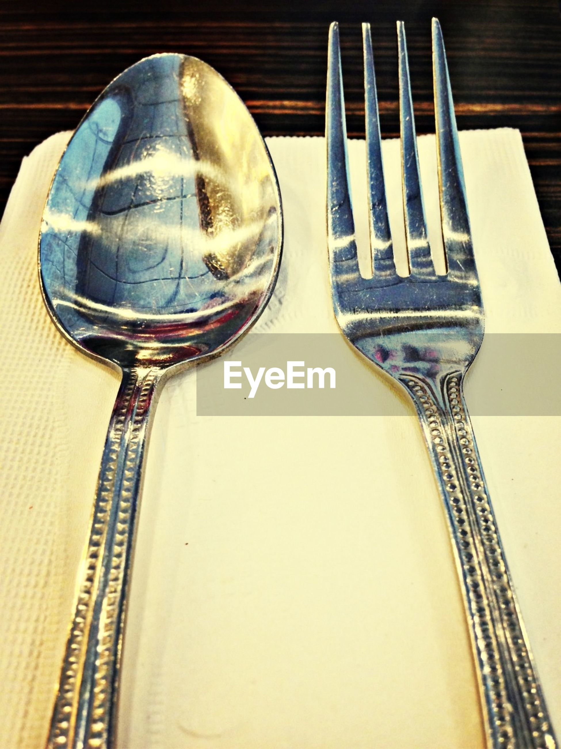 Close-up of silverware on napkin