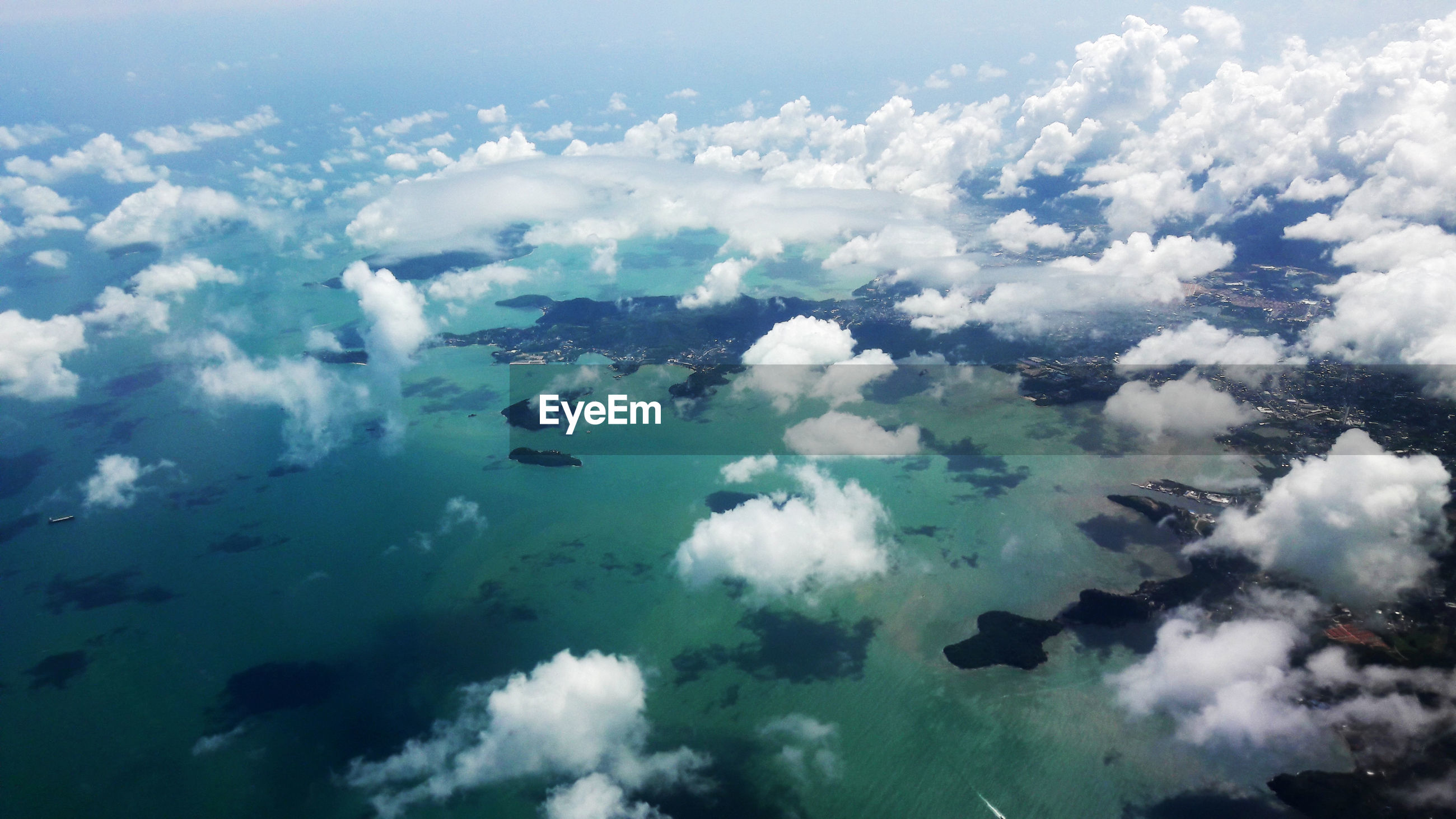 AERIAL SHOT OF CLOUDS OVER SEA