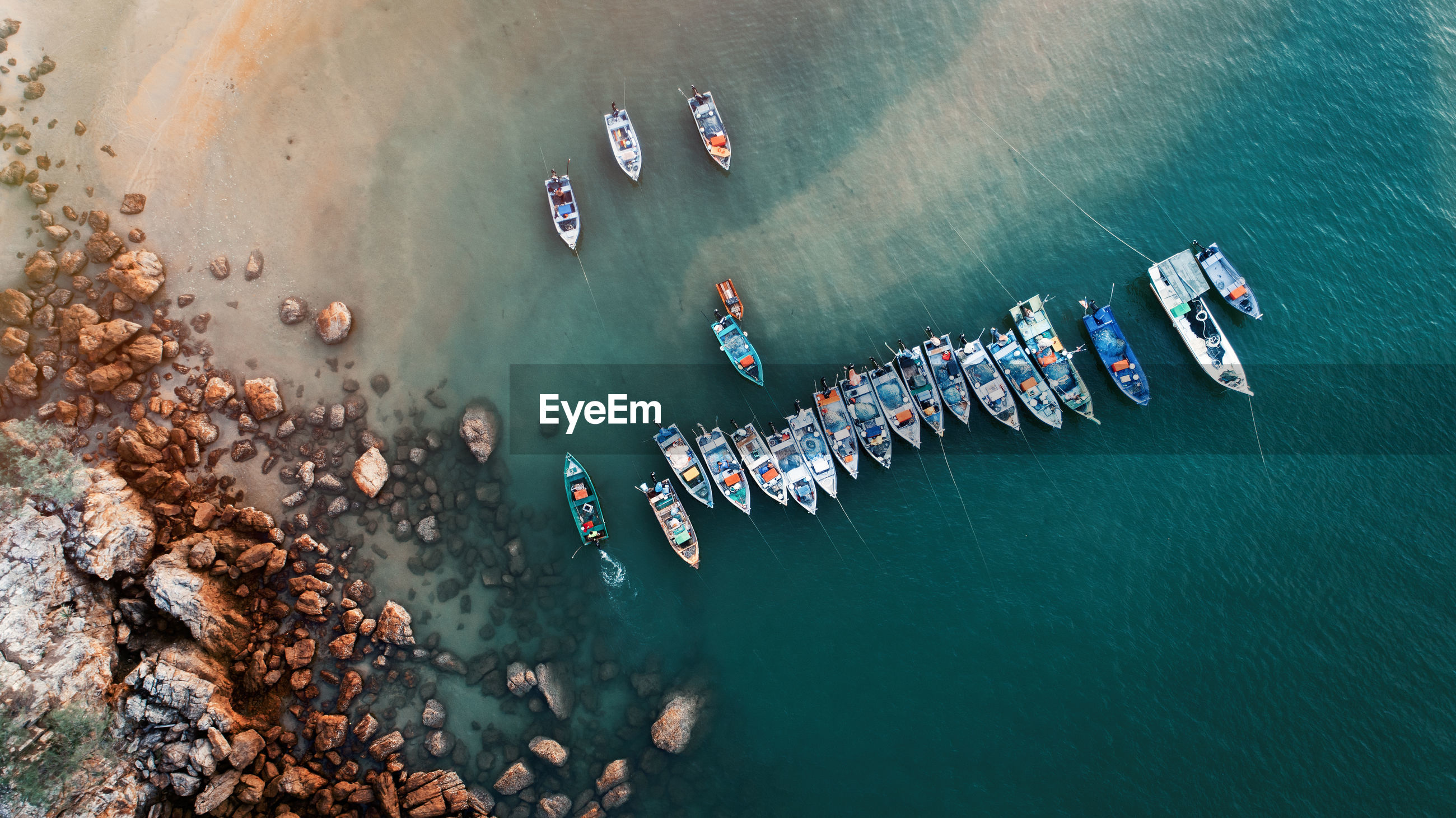 High angle view of boats on sea shore
