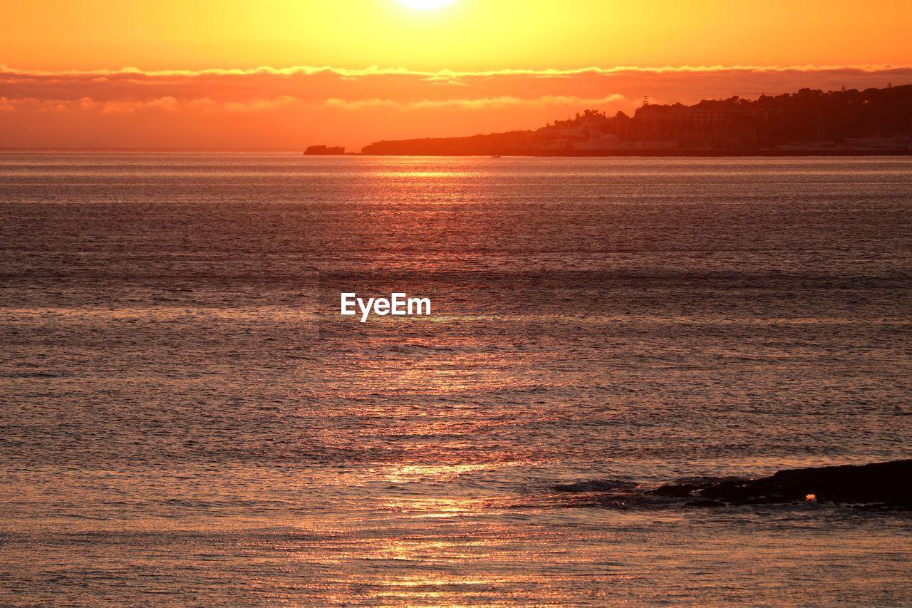 sunset, sky, beauty in nature, water, orange color, scenics - nature, tranquility, sea, tranquil scene, nature, waterfront, idyllic, no people, sunlight, horizon over water, cloud - sky, horizon, outdoors, sun, romantic sky