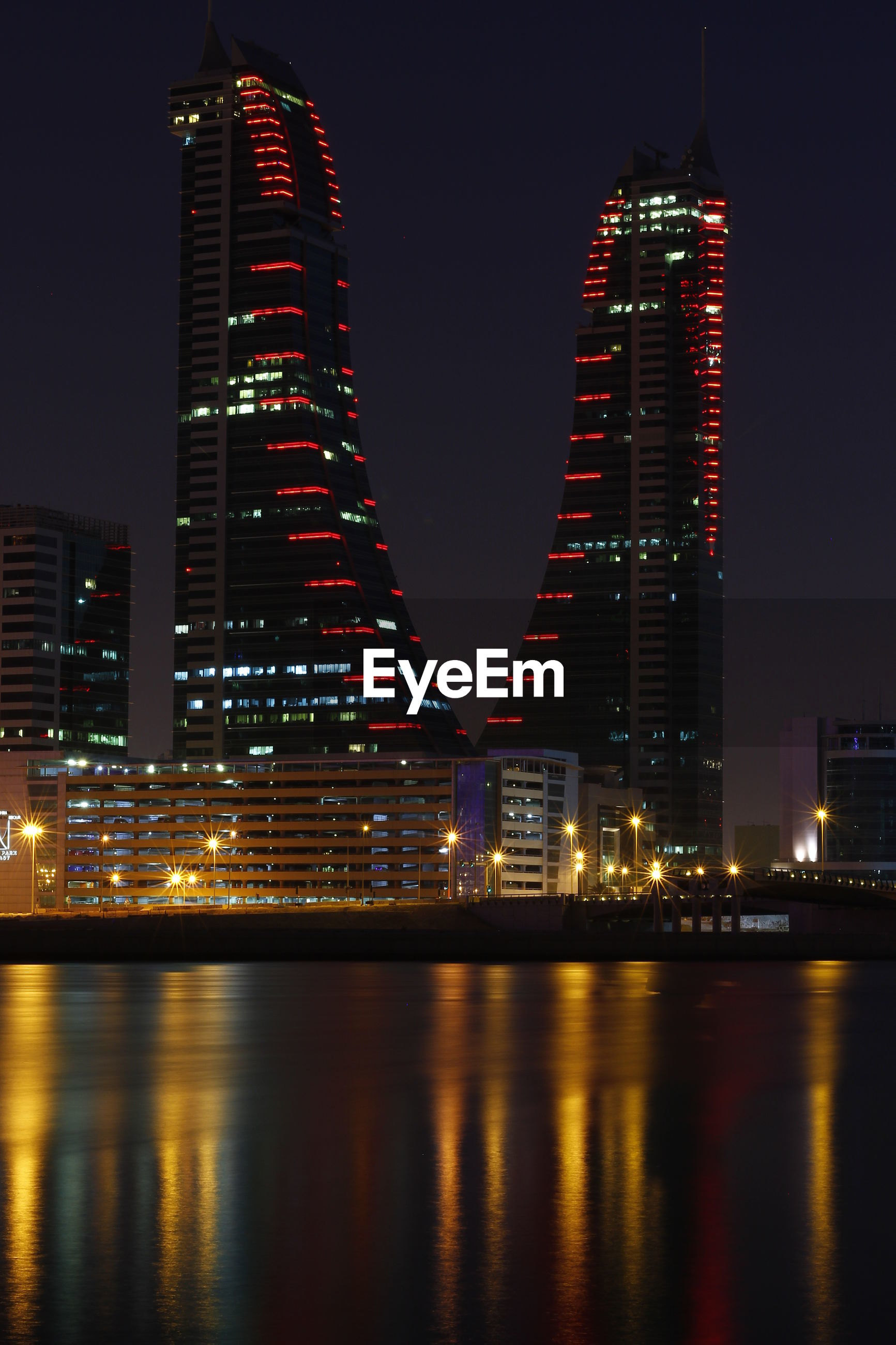 VIEW OF ILLUMINATED SKYSCRAPERS AT NIGHT