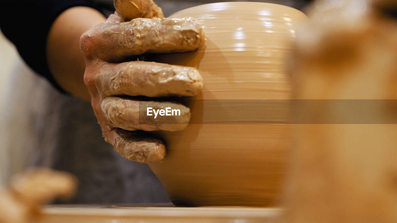 Close-Up Of Man Making Pottery