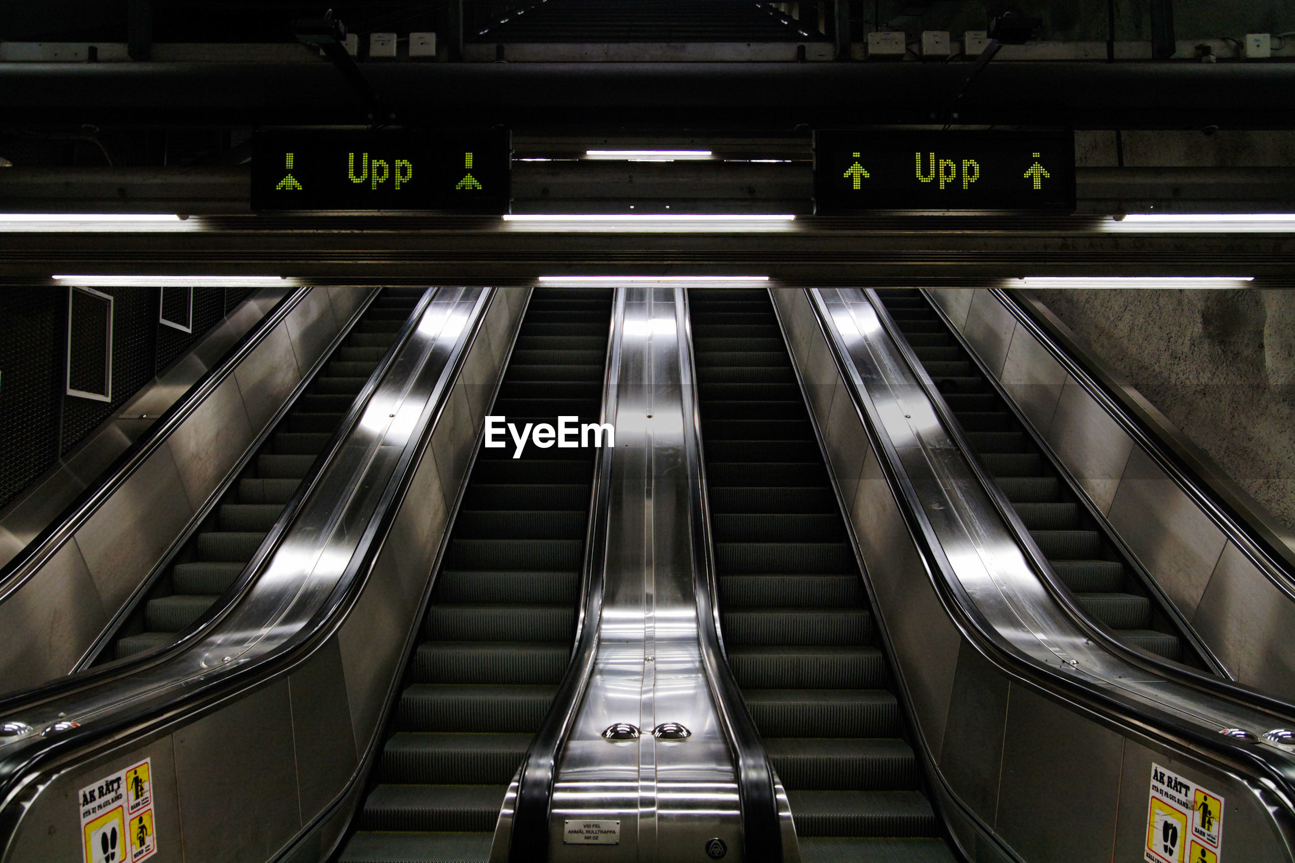 Low angle view of empty escalators at subway station