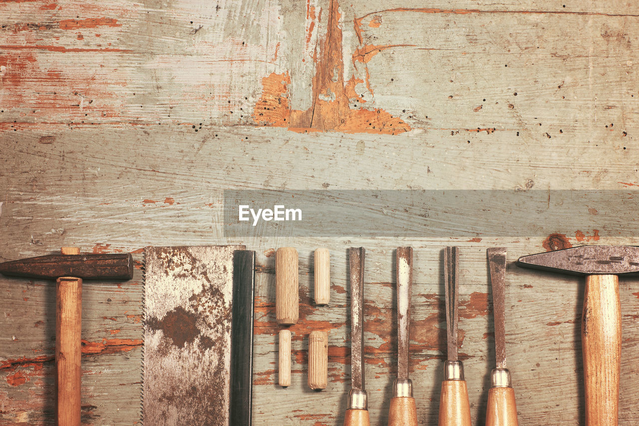 Carpentry Tools In Row On Wooden Table