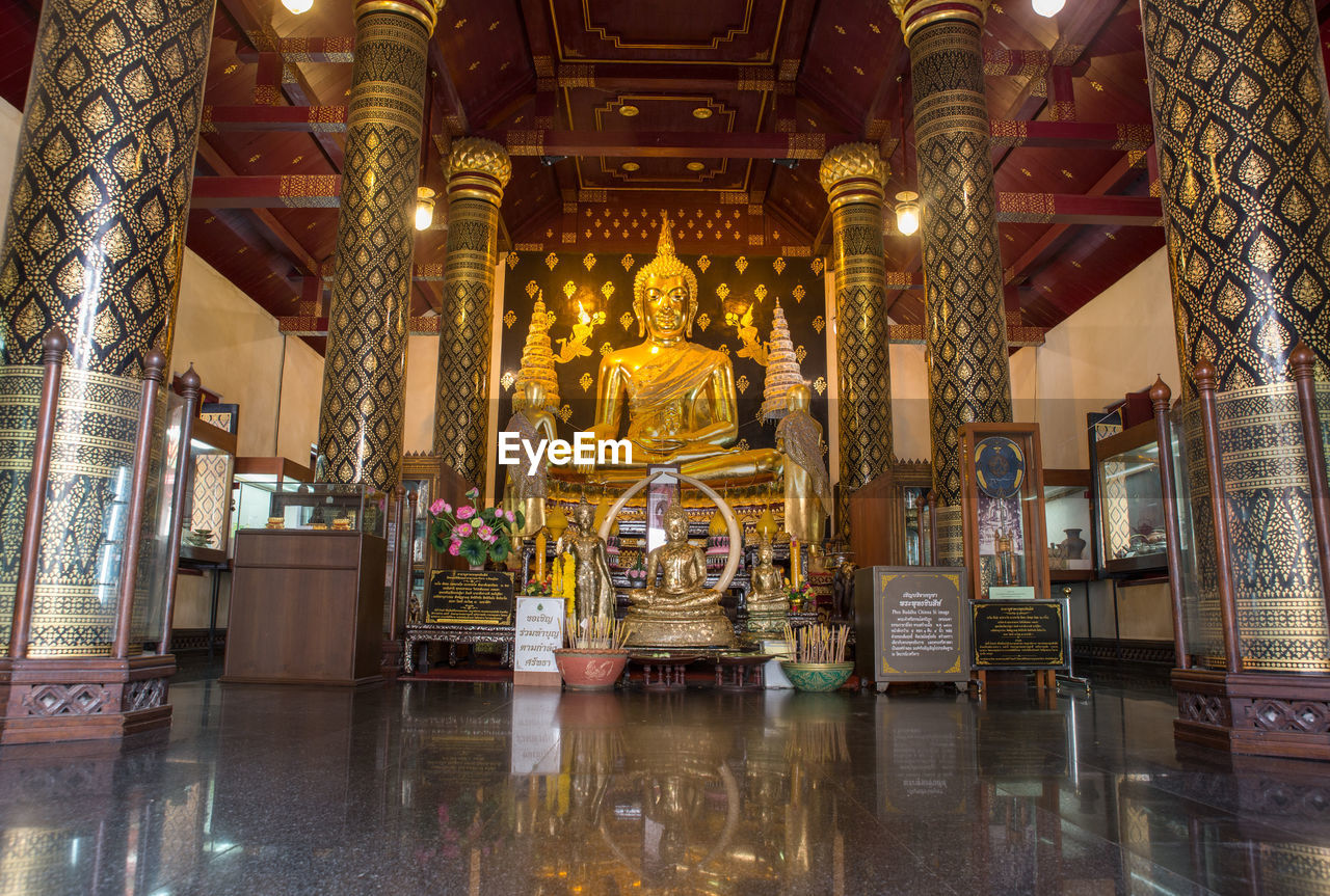 religion, architecture, built structure, place of worship, building, spirituality, belief, statue, sculpture, human representation, representation, male likeness, art and craft, indoors, gold colored, travel destinations, no people, ornate, idol, architectural column
