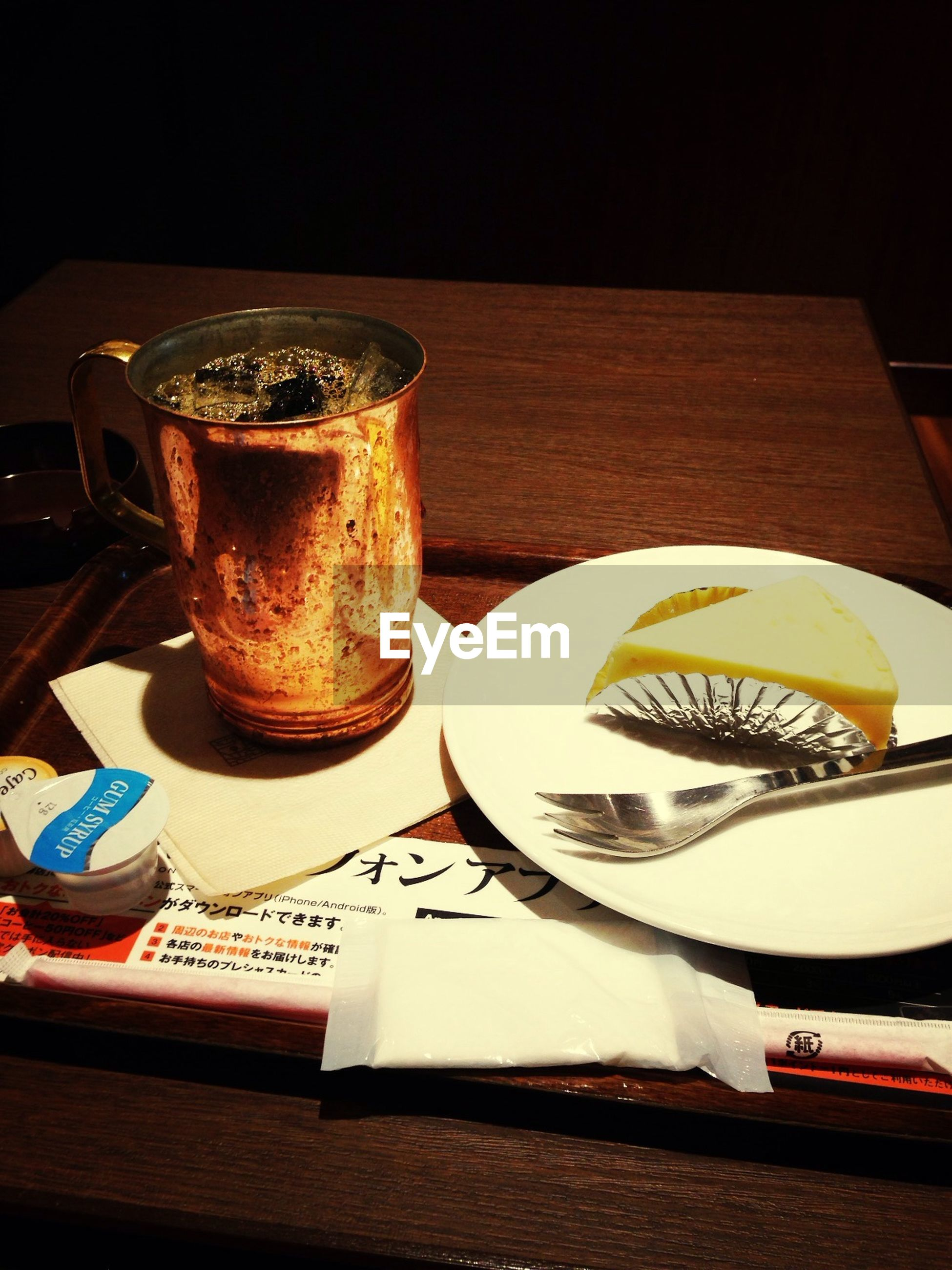 indoors, table, still life, food and drink, drink, wood - material, high angle view, coffee cup, directly above, refreshment, close-up, spoon, no people, plate, freshness, fork, coffee, coffee - drink, saucer, cup