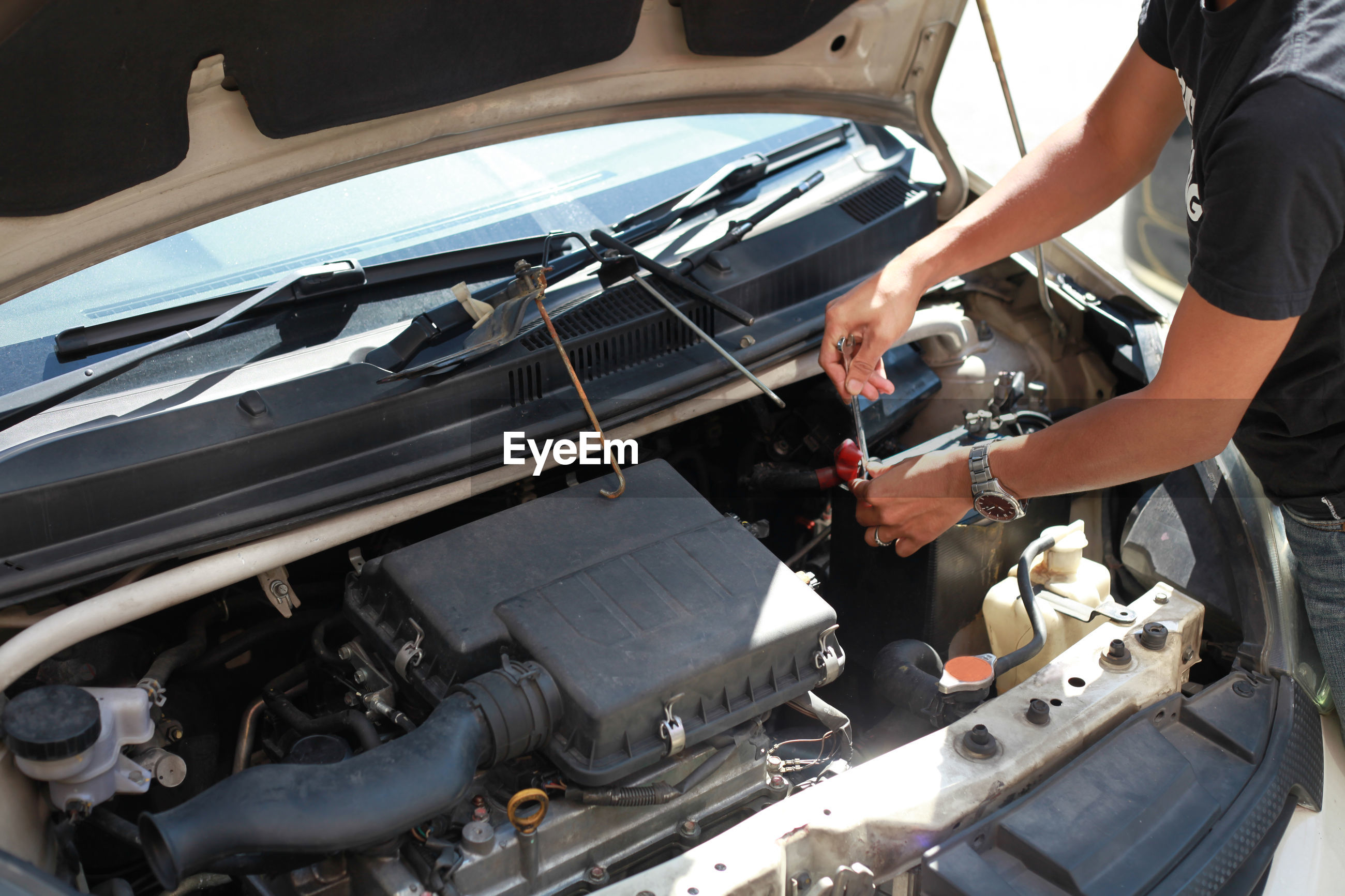 High angle view of man working on car
