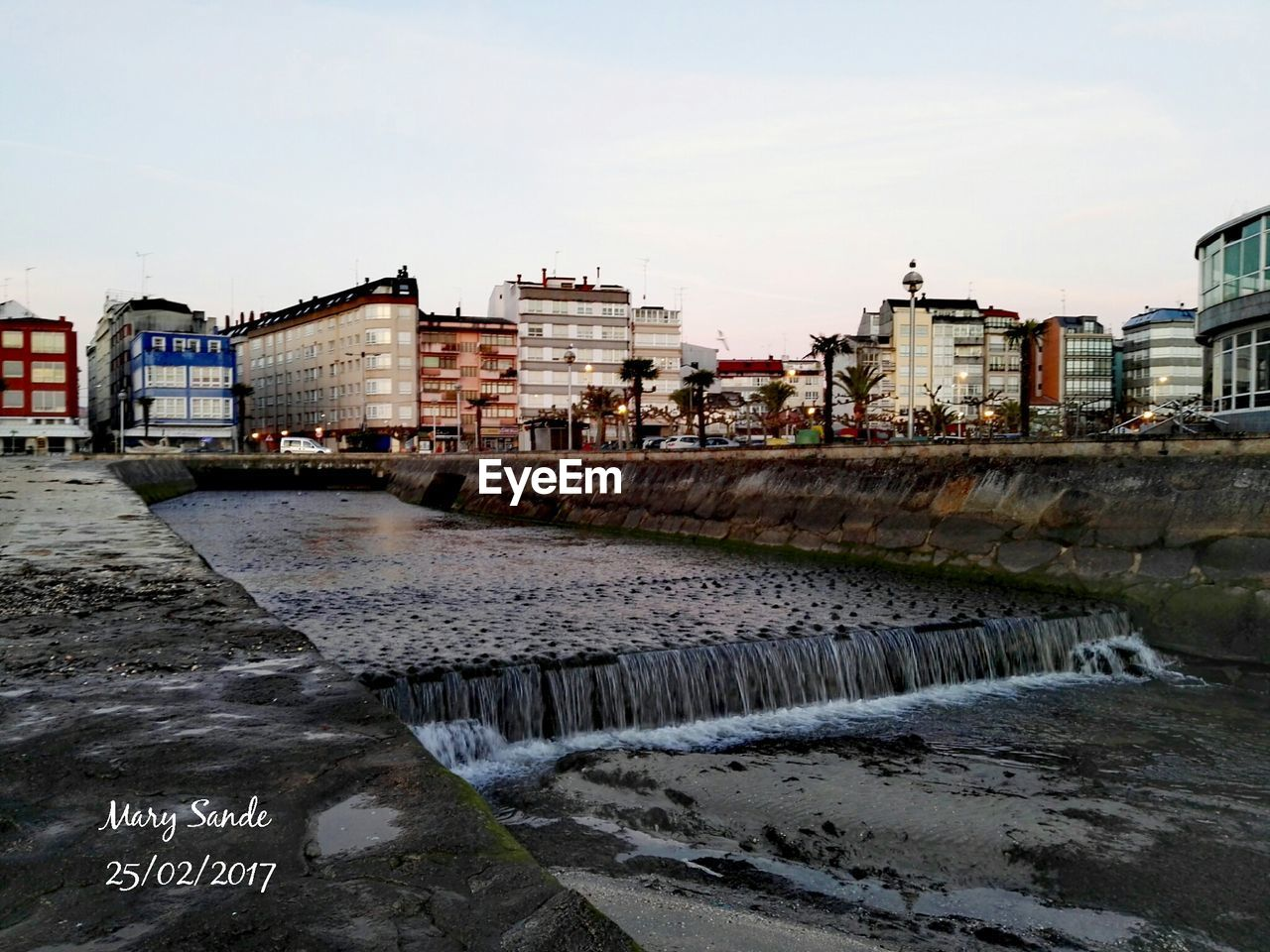 architecture, built structure, building exterior, water, river, sky, day, outdoors, bridge - man made structure, cloud - sky, city, motion, no people, power in nature, nature