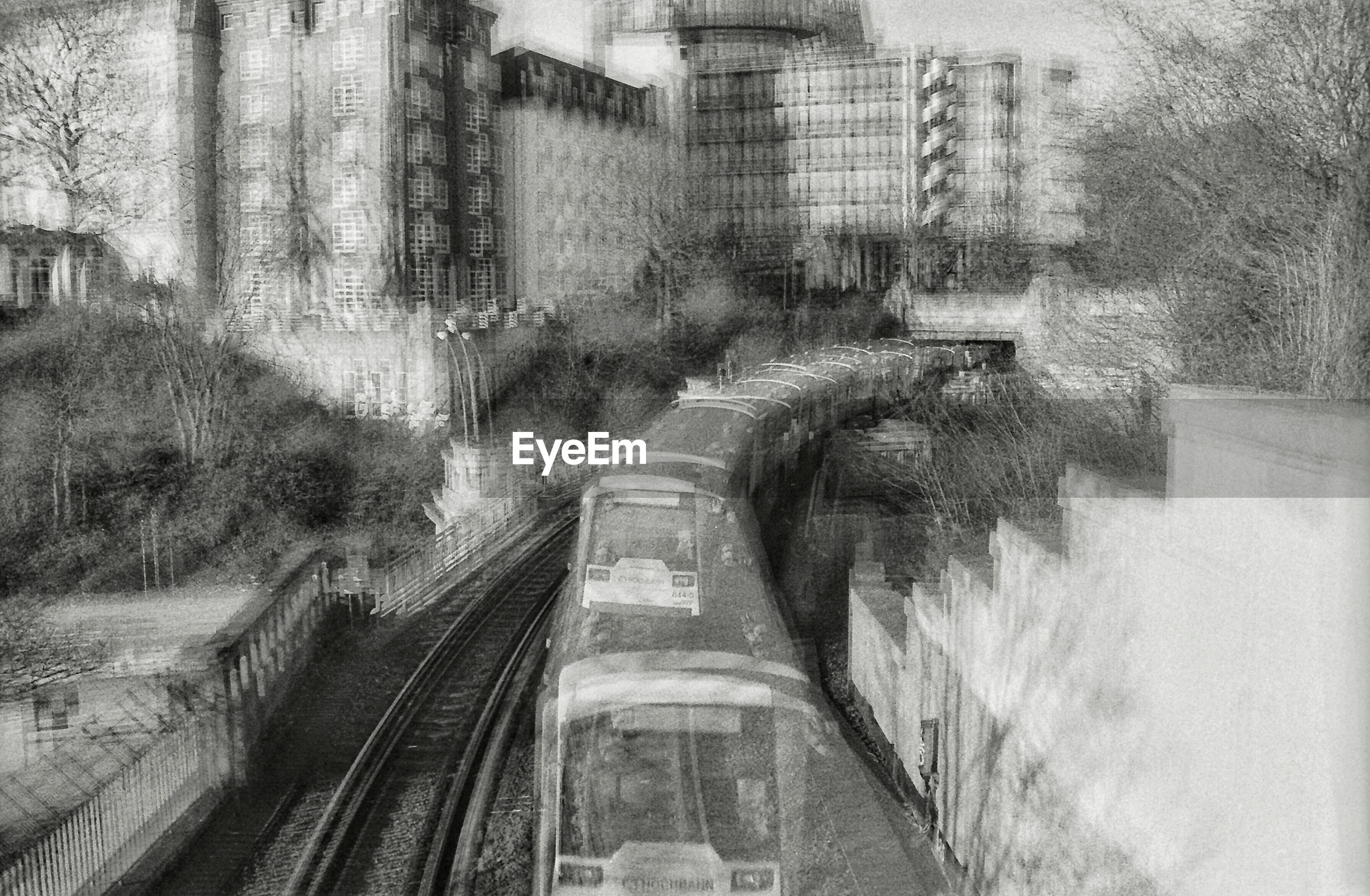 Blurred motion of train moving in city