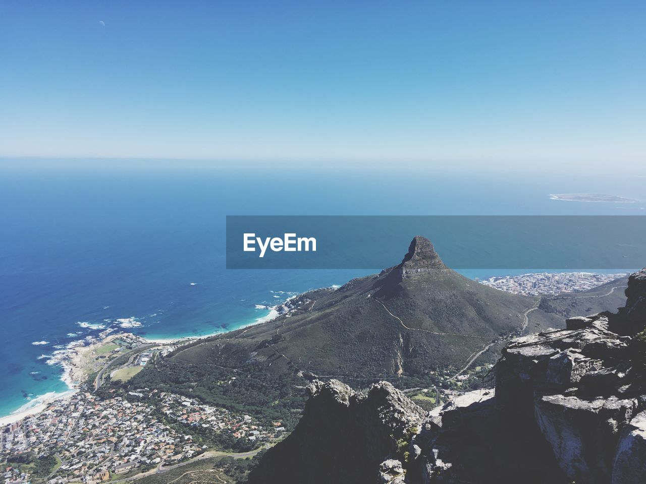 Scenic View Of Table Mountain And Sea Against Clear Blue Sky