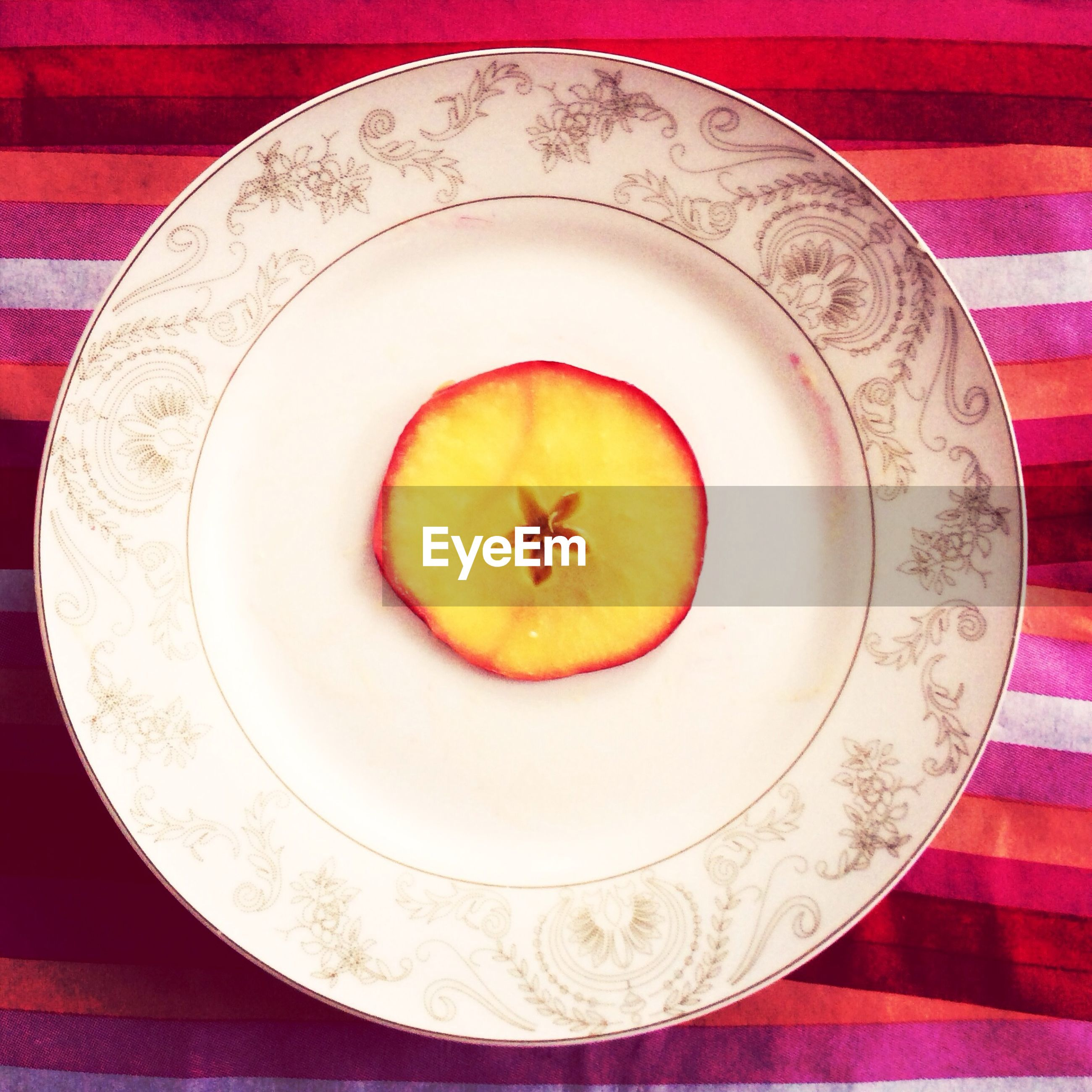 indoors, food and drink, circle, directly above, high angle view, table, food, still life, red, freshness, plate, fruit, healthy eating, yellow, close-up, no people, geometric shape, bowl, decoration, pattern