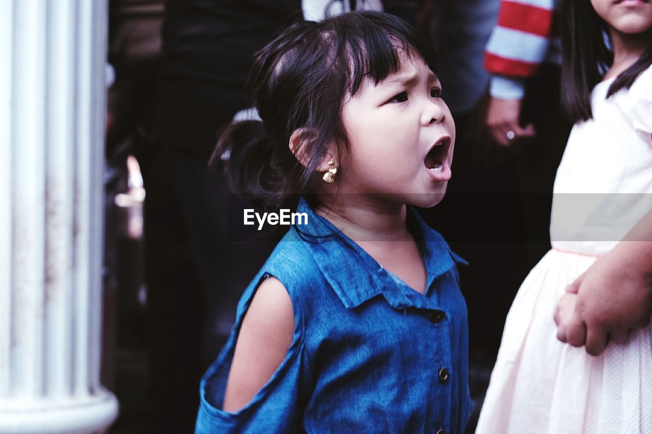 Girl Shouting At Social Gathering