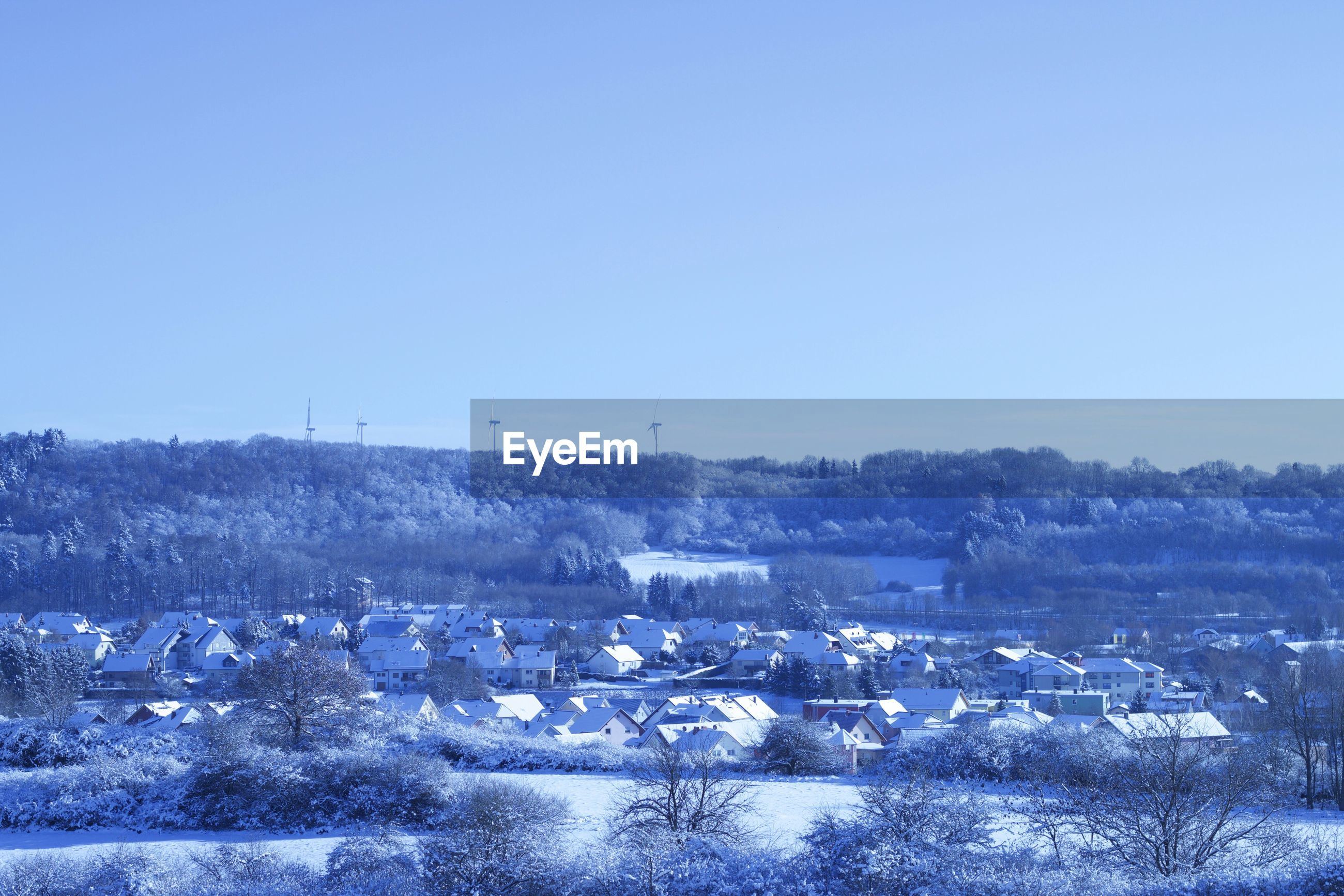 SCENIC VIEW OF WINTER LANDSCAPE AGAINST CLEAR SKY