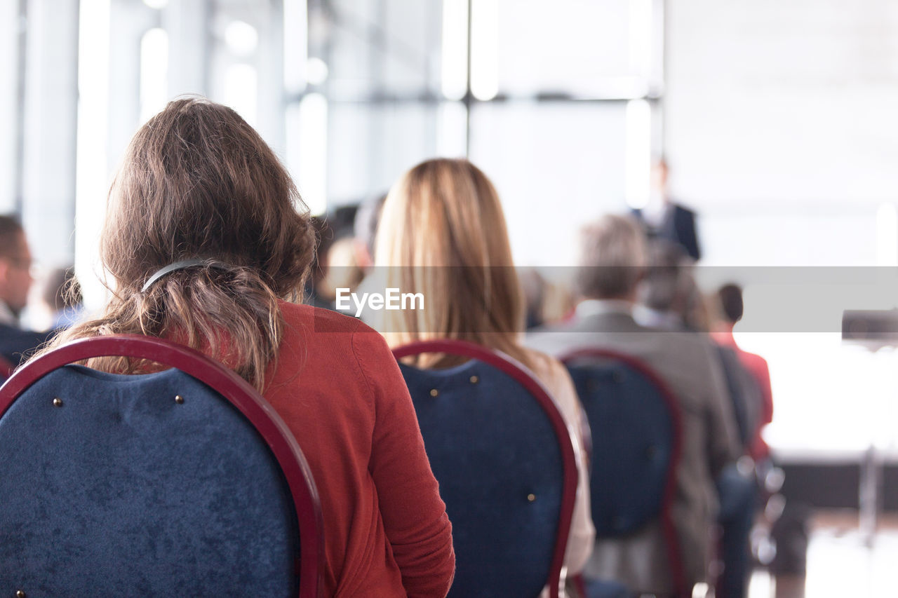 Rear View Of People In Seminar