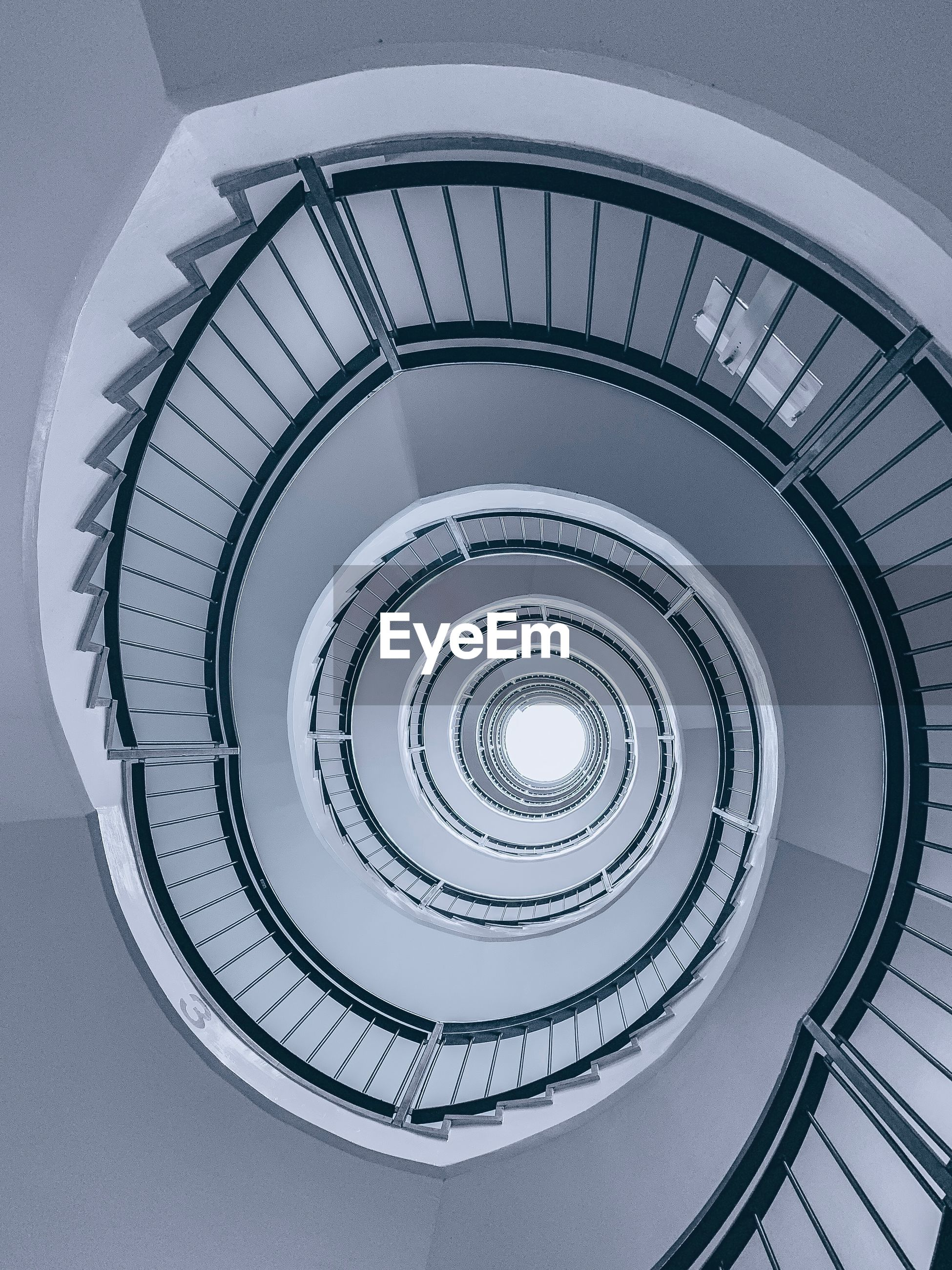 Directly above shot of spiral staircase in building