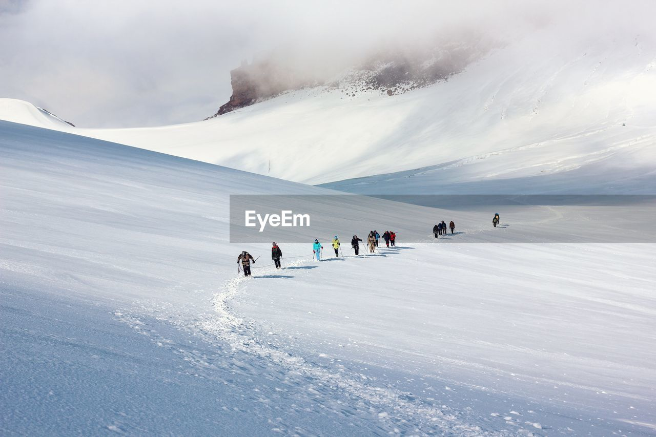 People On Snowcapped Mountain