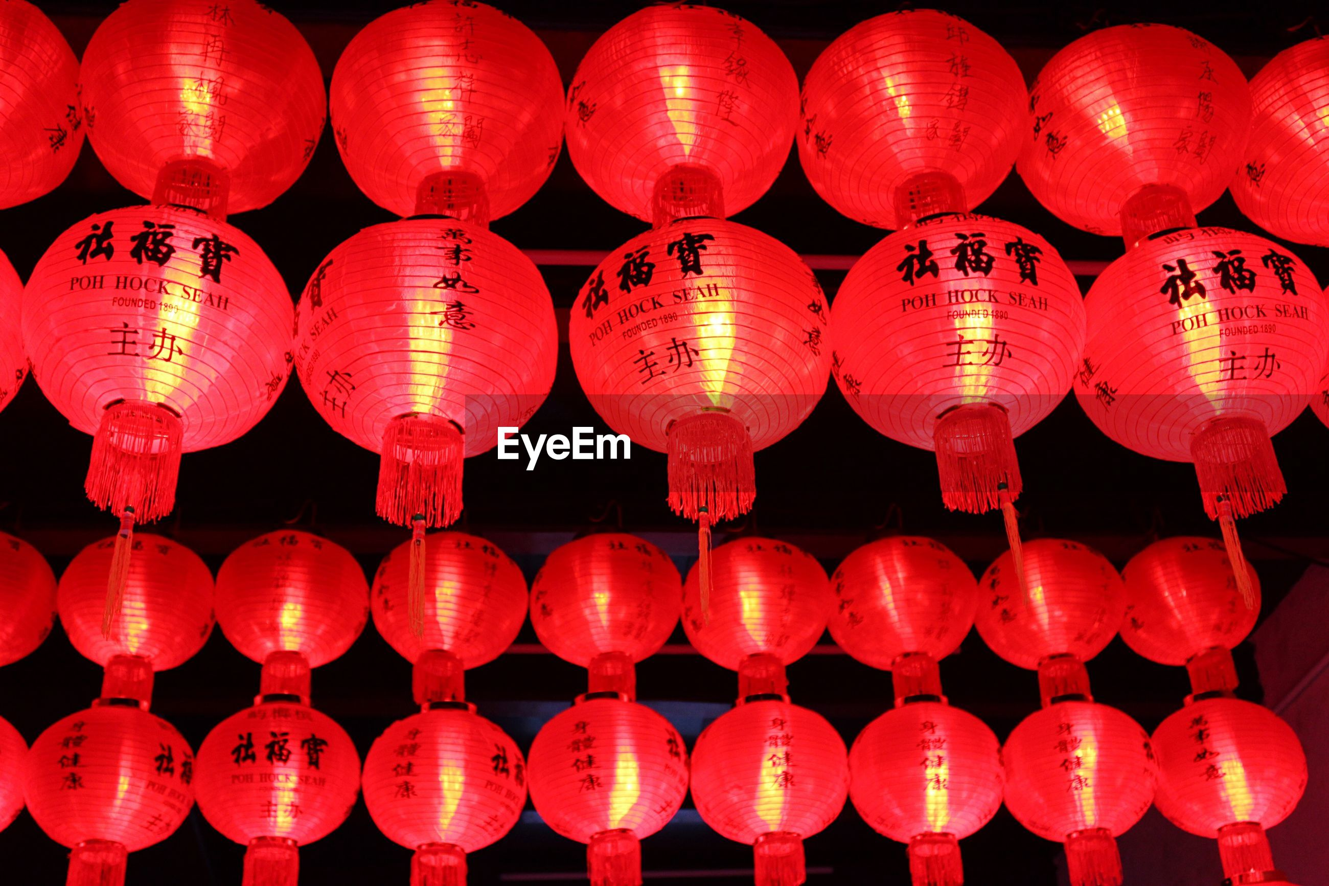 Full frame shot of red illuminated lanterns