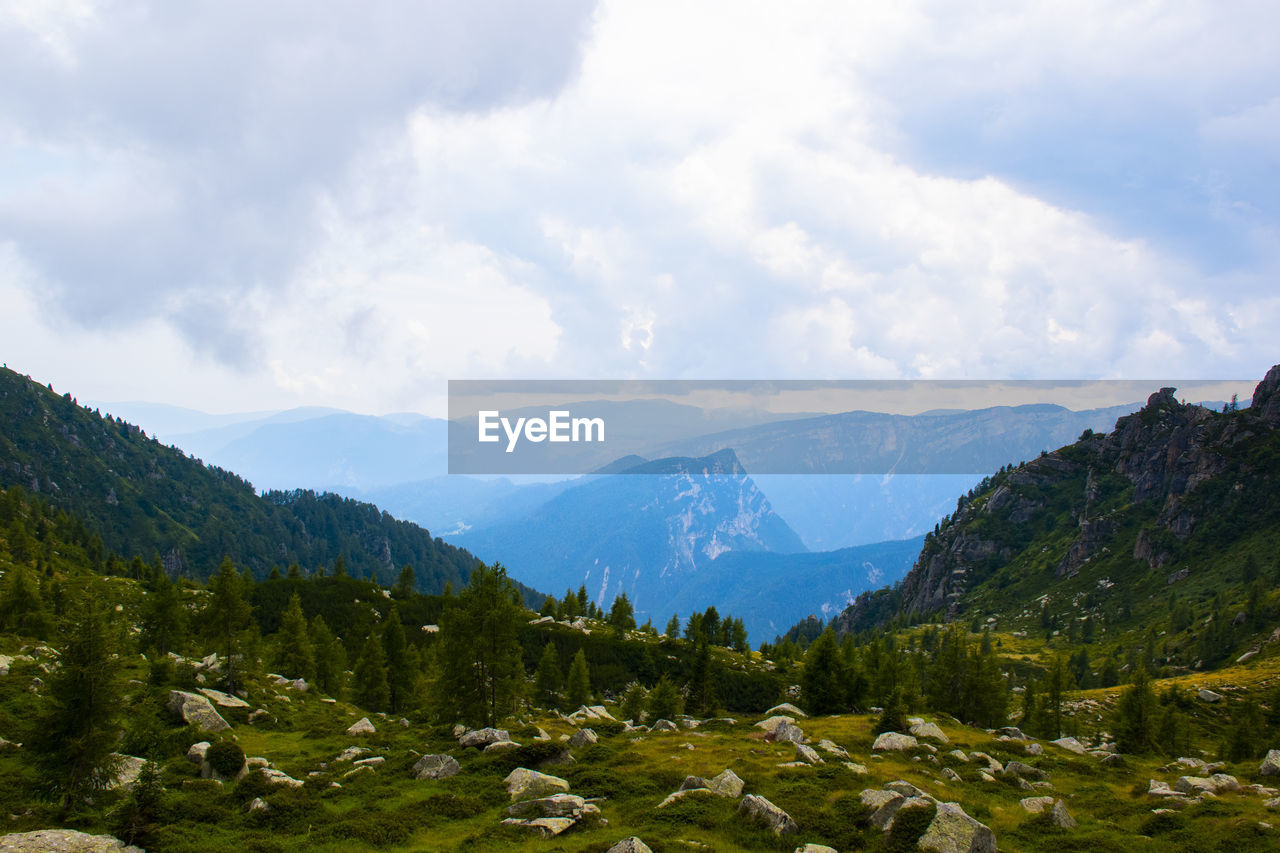 mountain, cloud - sky, sky, beauty in nature, scenics - nature, tranquil scene, mountain range, tranquility, environment, non-urban scene, landscape, nature, no people, day, idyllic, plant, outdoors, land, green color, rock, range, mountain peak