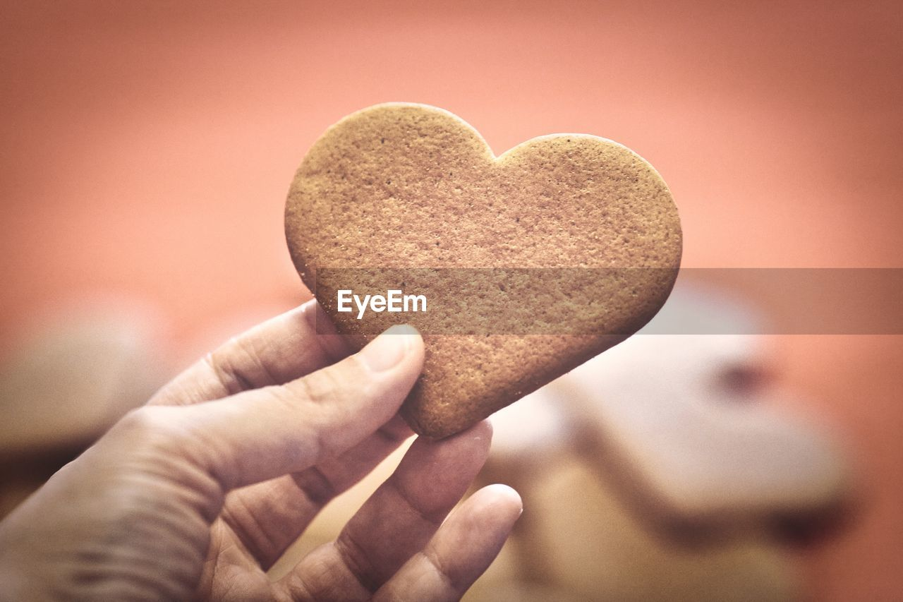 Hand holding a heart cookie