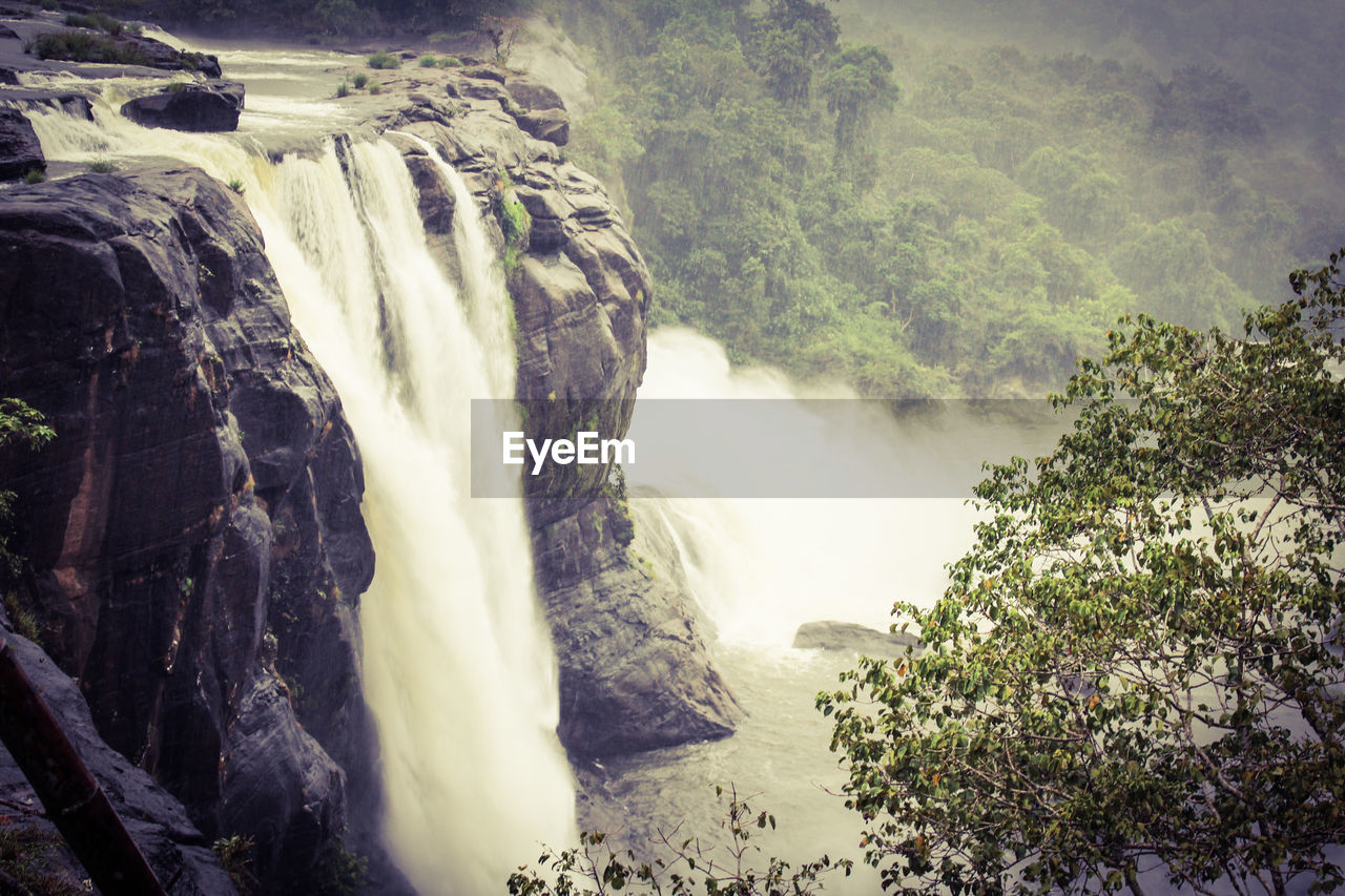 waterfall, nature, motion, scenics, water, beauty in nature, river, tourism, long exposure, outdoors, day, rock - object, no people, power in nature, tree, travel, rapid, travel destinations, landscape, cliff, mountain
