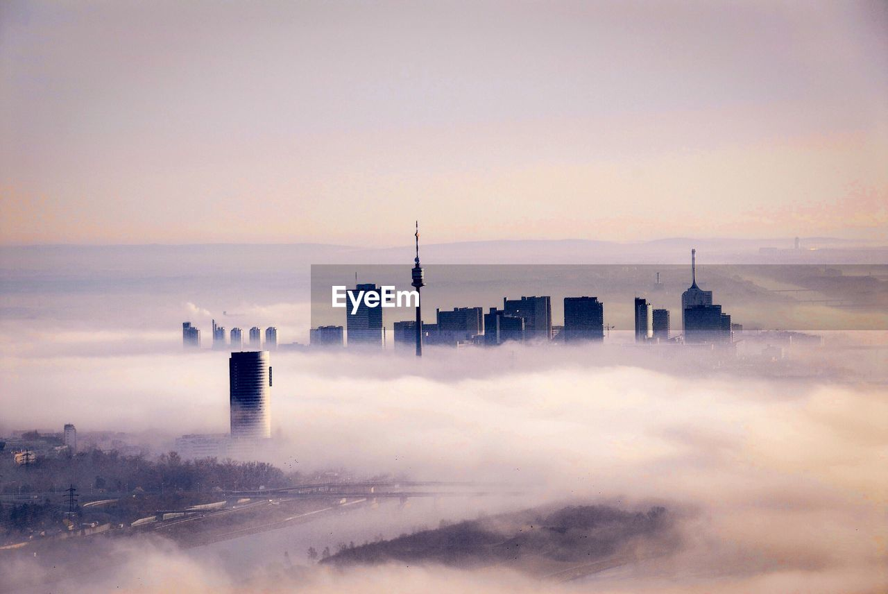 SCENIC VIEW OF CITY AND Clouds