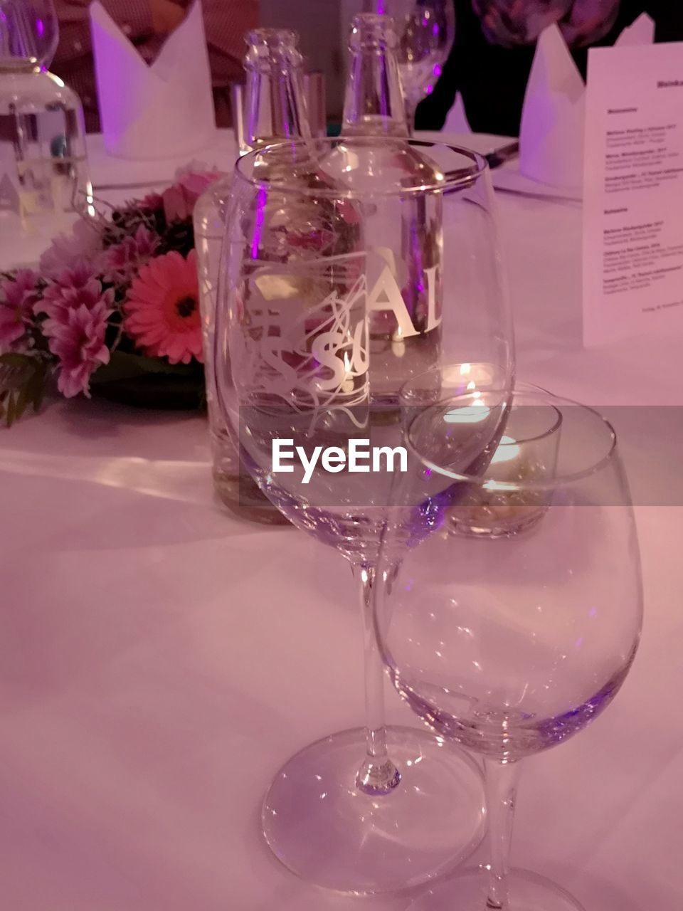 drink, refreshment, glass, table, indoors, food and drink, wineglass, household equipment, alcohol, transparent, drinking glass, glass - material, close-up, restaurant, freshness, business, wine, still life, no people, cocktail, purple